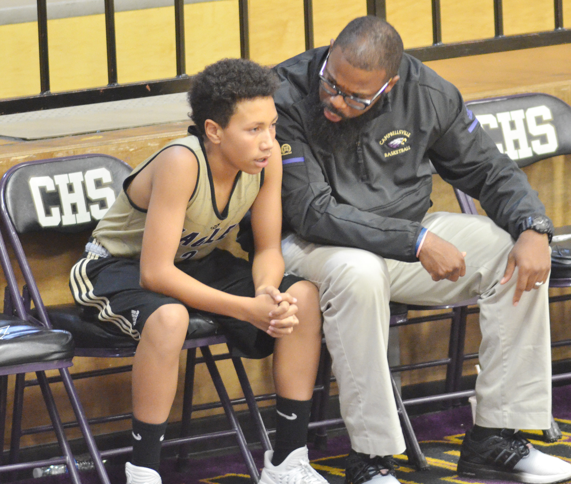 CHS freshman Jastyn Shively talks to assistant coach Will Griffin.