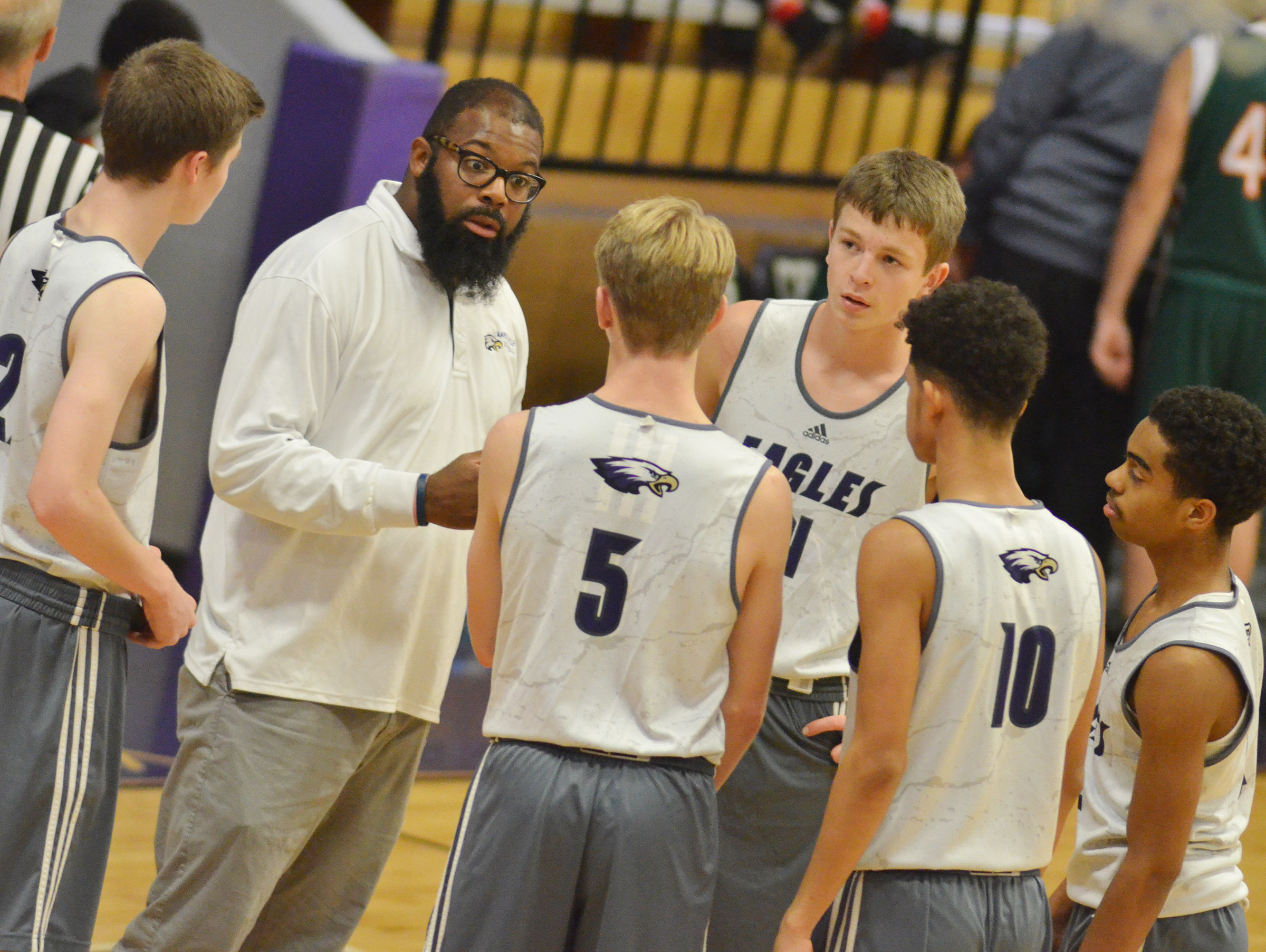 CHS boys' basketball assistant coach Will Griffin talks to his players.