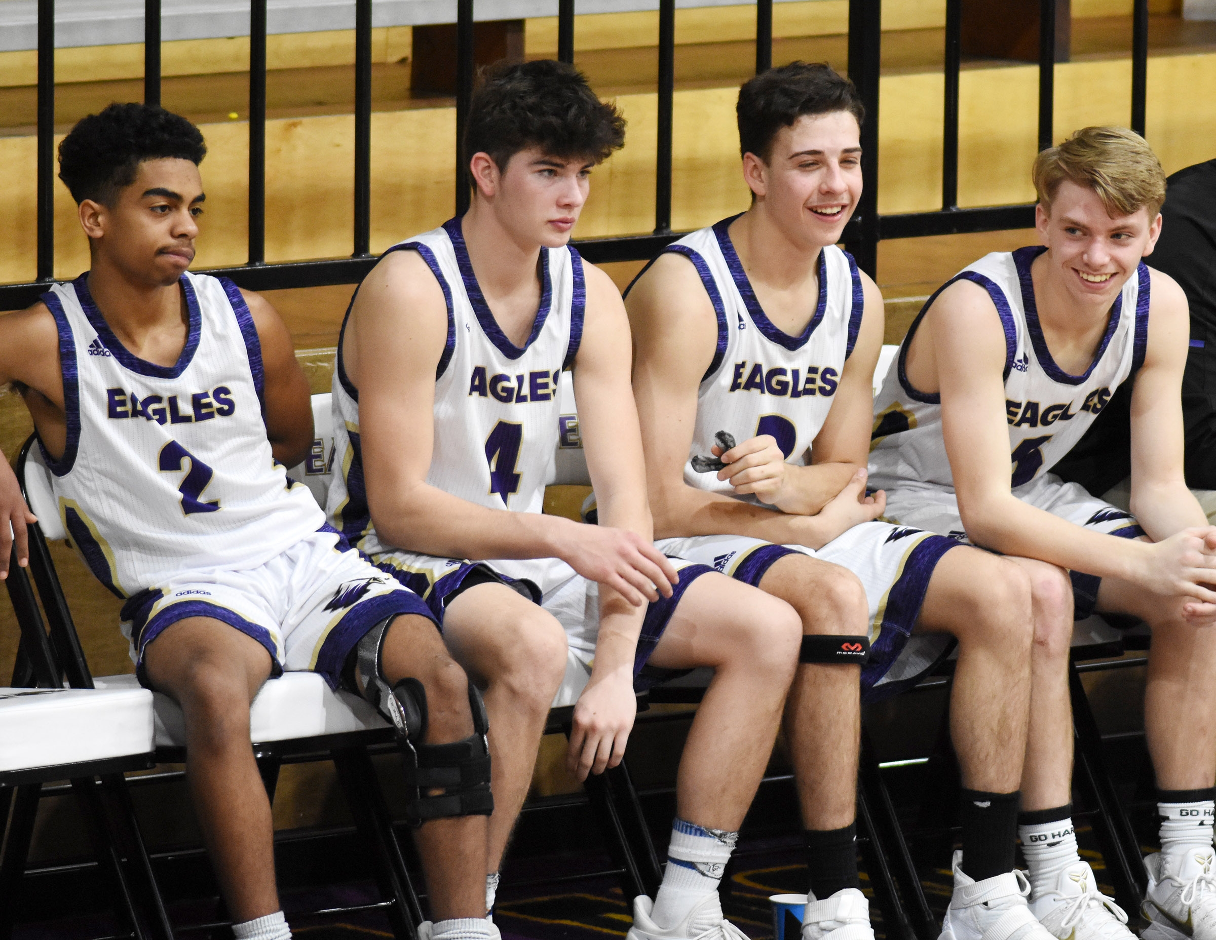 From left, CHS junior Davon Cecil, sophomore Mark Rigsby and freshmen John Orberson and Arren Hash talk as they sit on the bench.