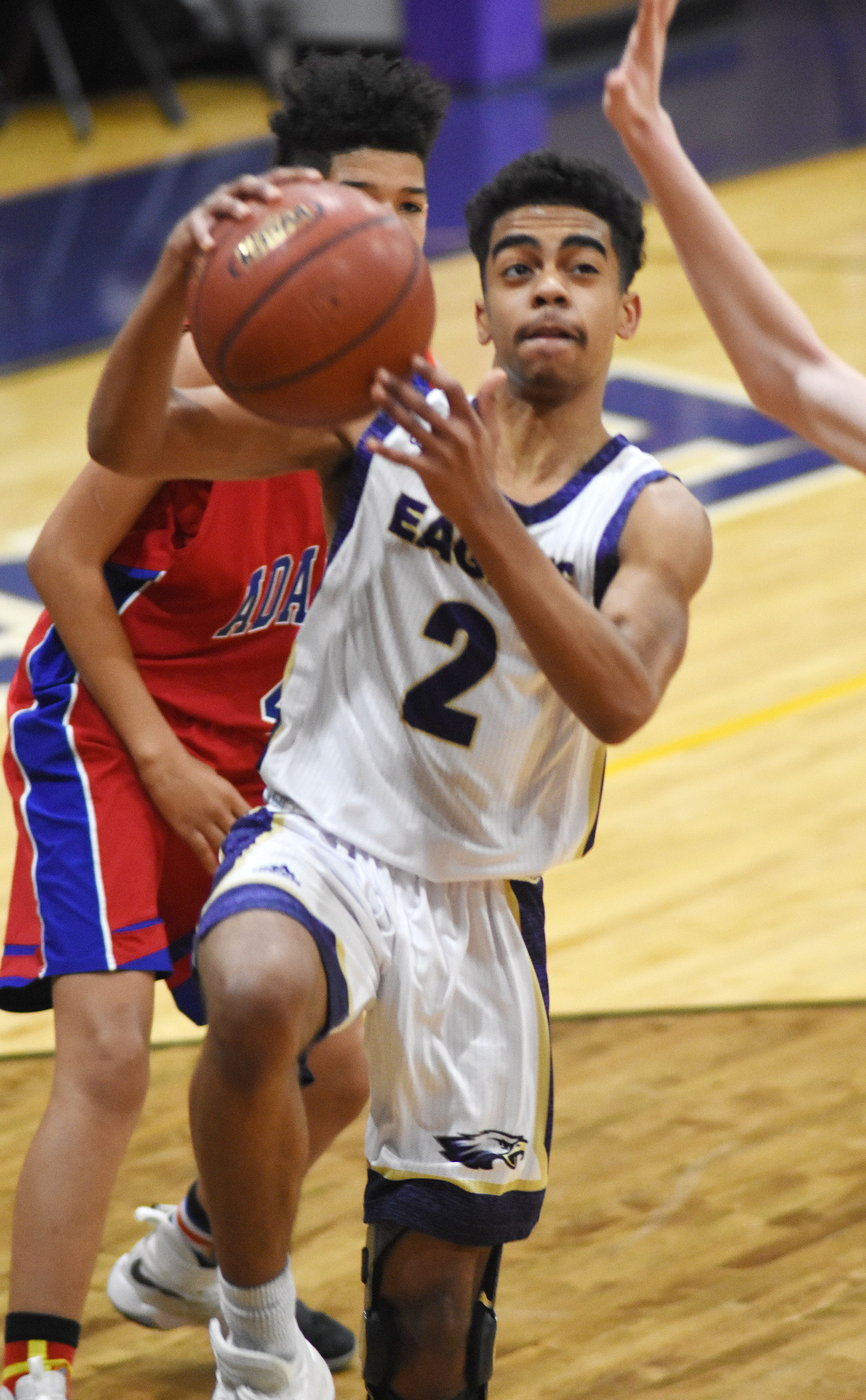 CHS junior Davon Cecil drives the ball to the basket.