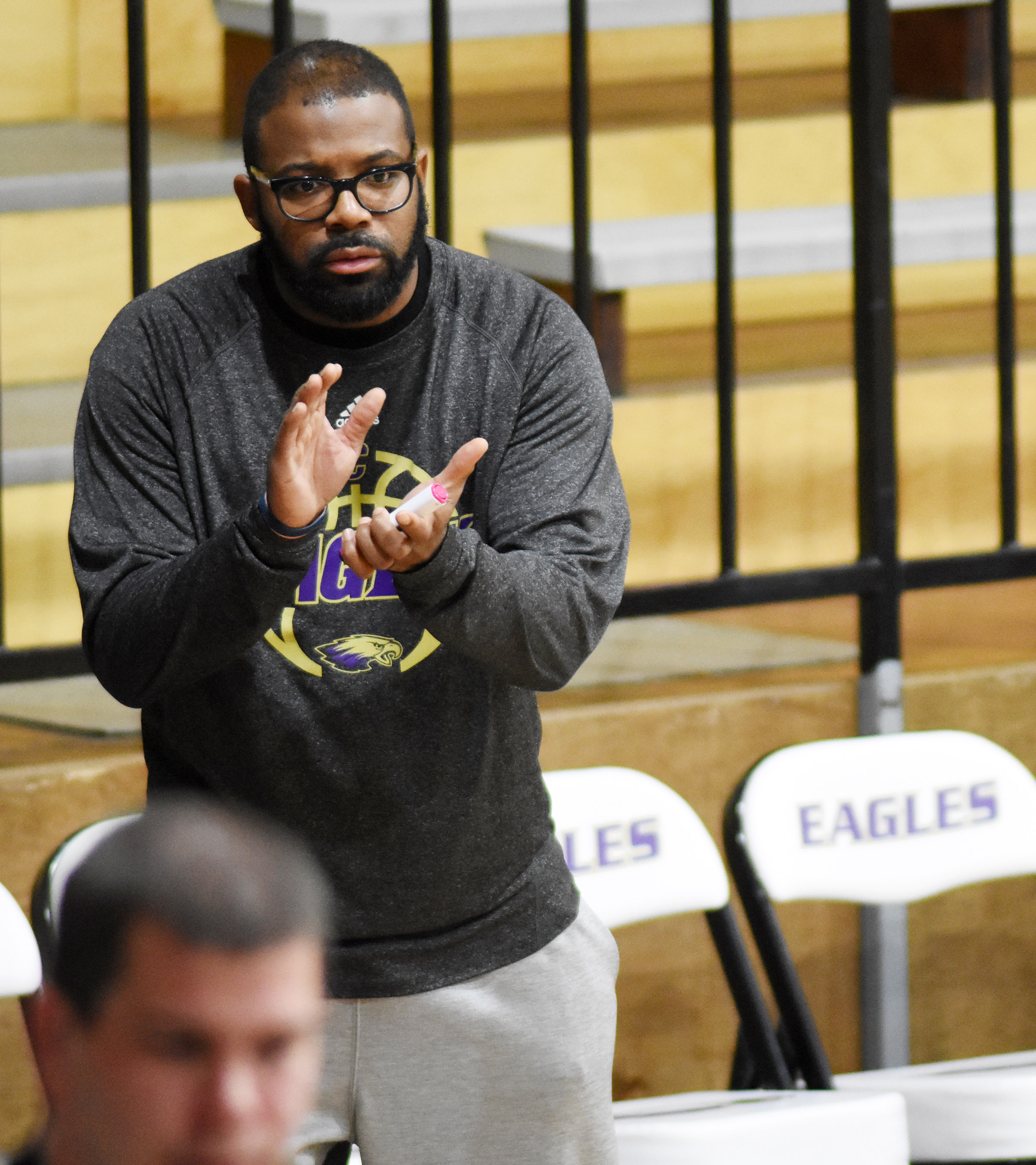 CHS boys' basketball assistant coach Will Griffin cheers for his team.