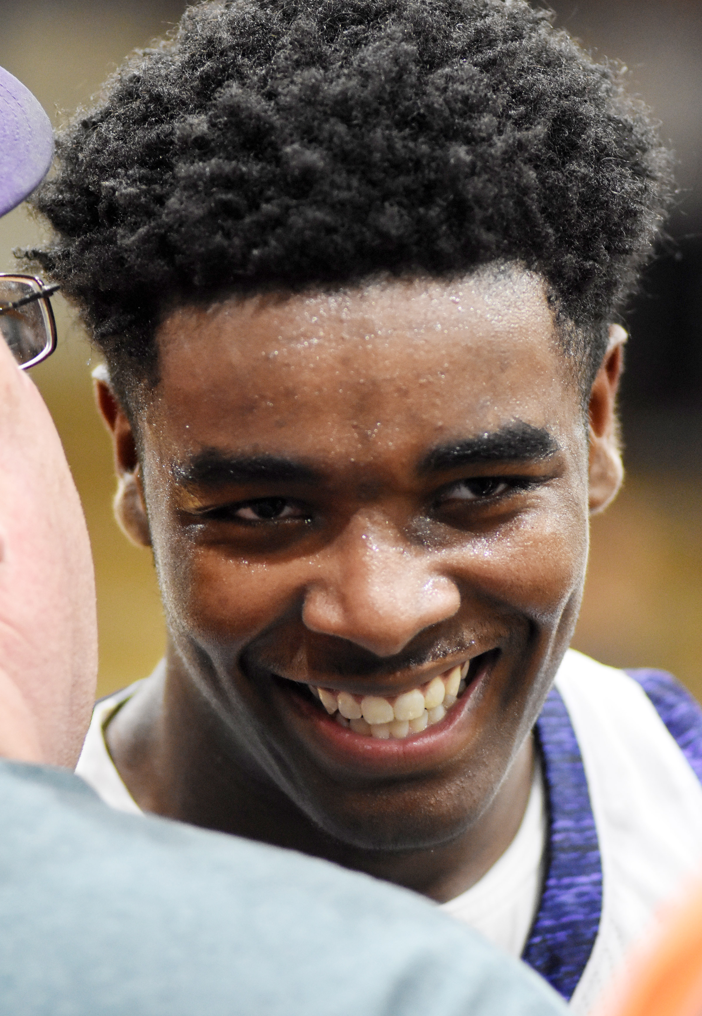 CHS senior Chanson Atkinson smiles as he is congratulated.