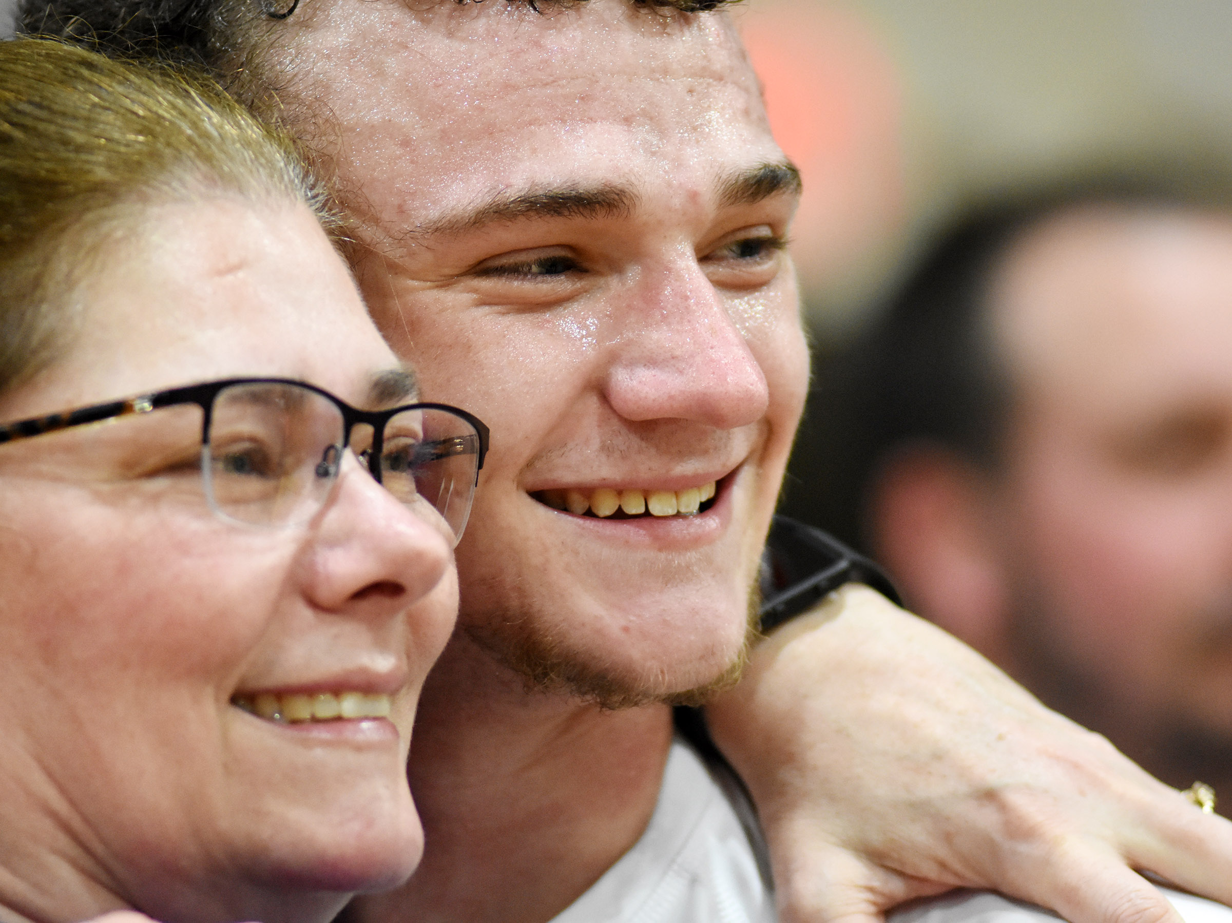 CHS senior Connor Wilson smiles with his mother, Tammy, after the game.
