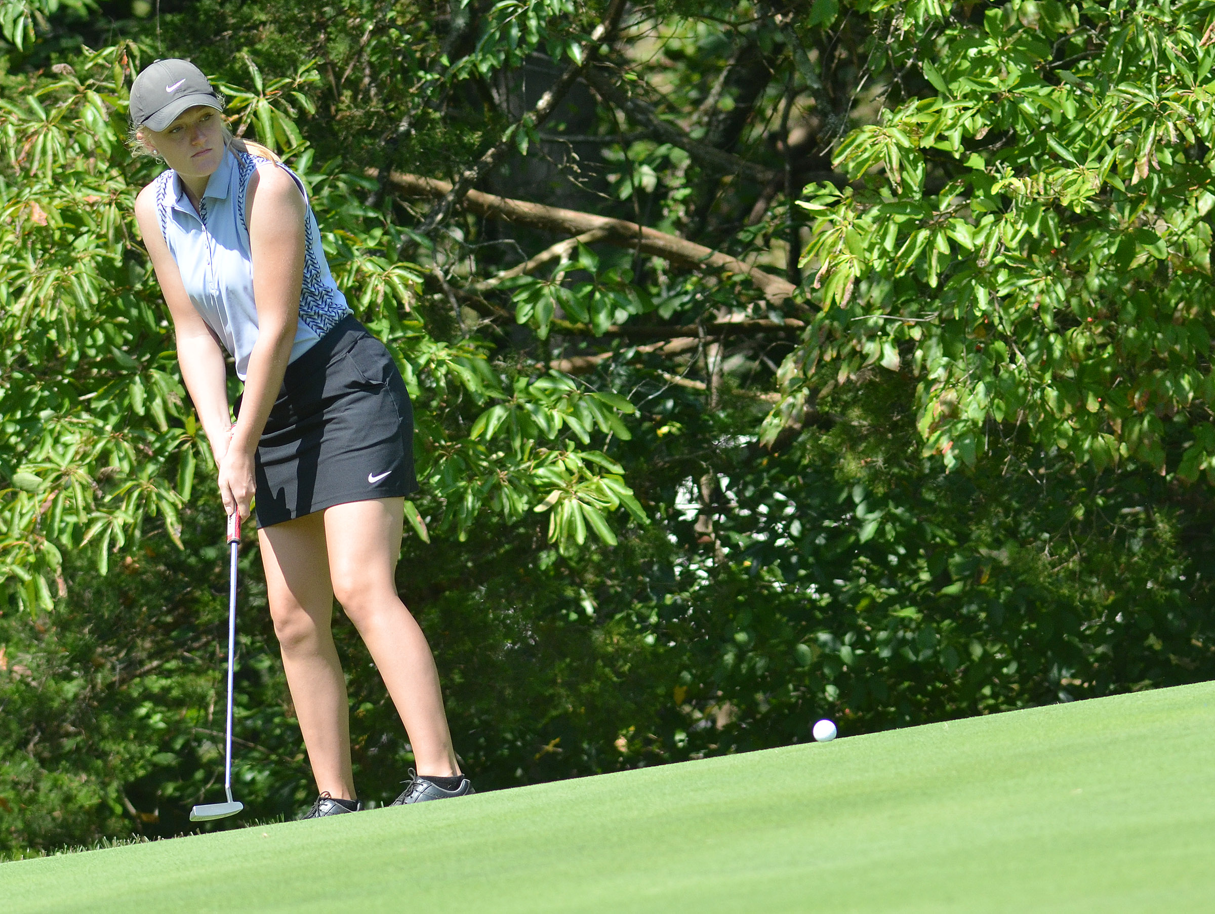 CHS junior Abbie Dicken putts.
