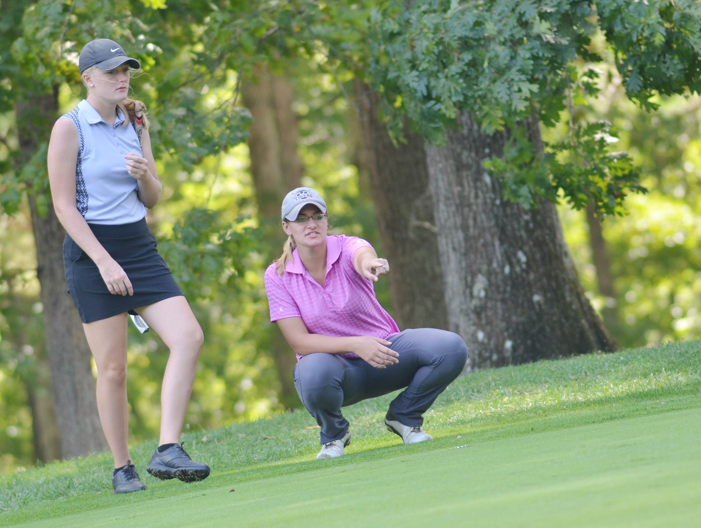 CHS junior Abbie Dicken lines up a shot, with help from coach Ashley Goodin.