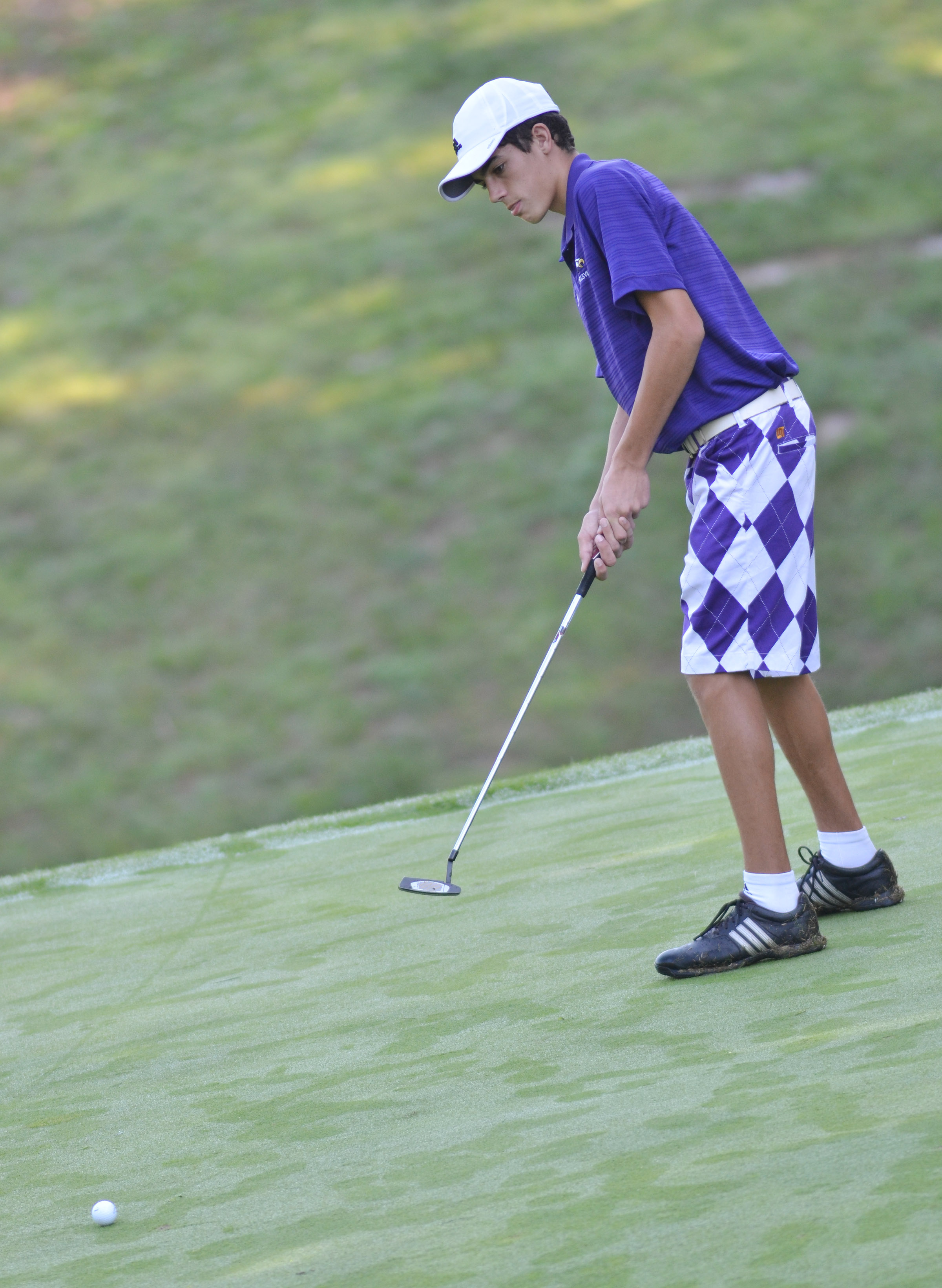 CHS freshman Kameron Smith putts.