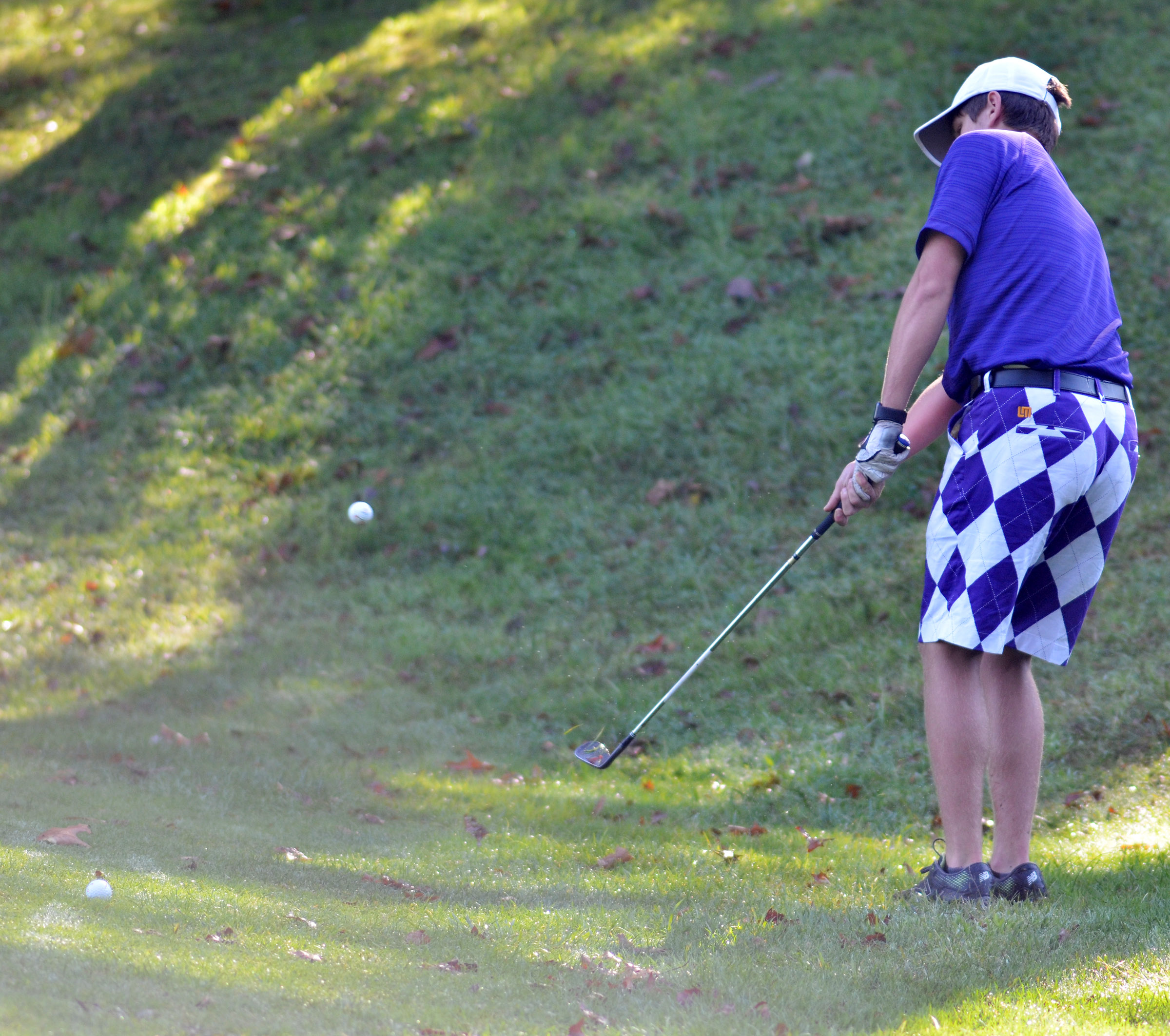 CHS junior Myles Murrell chips onto the green.