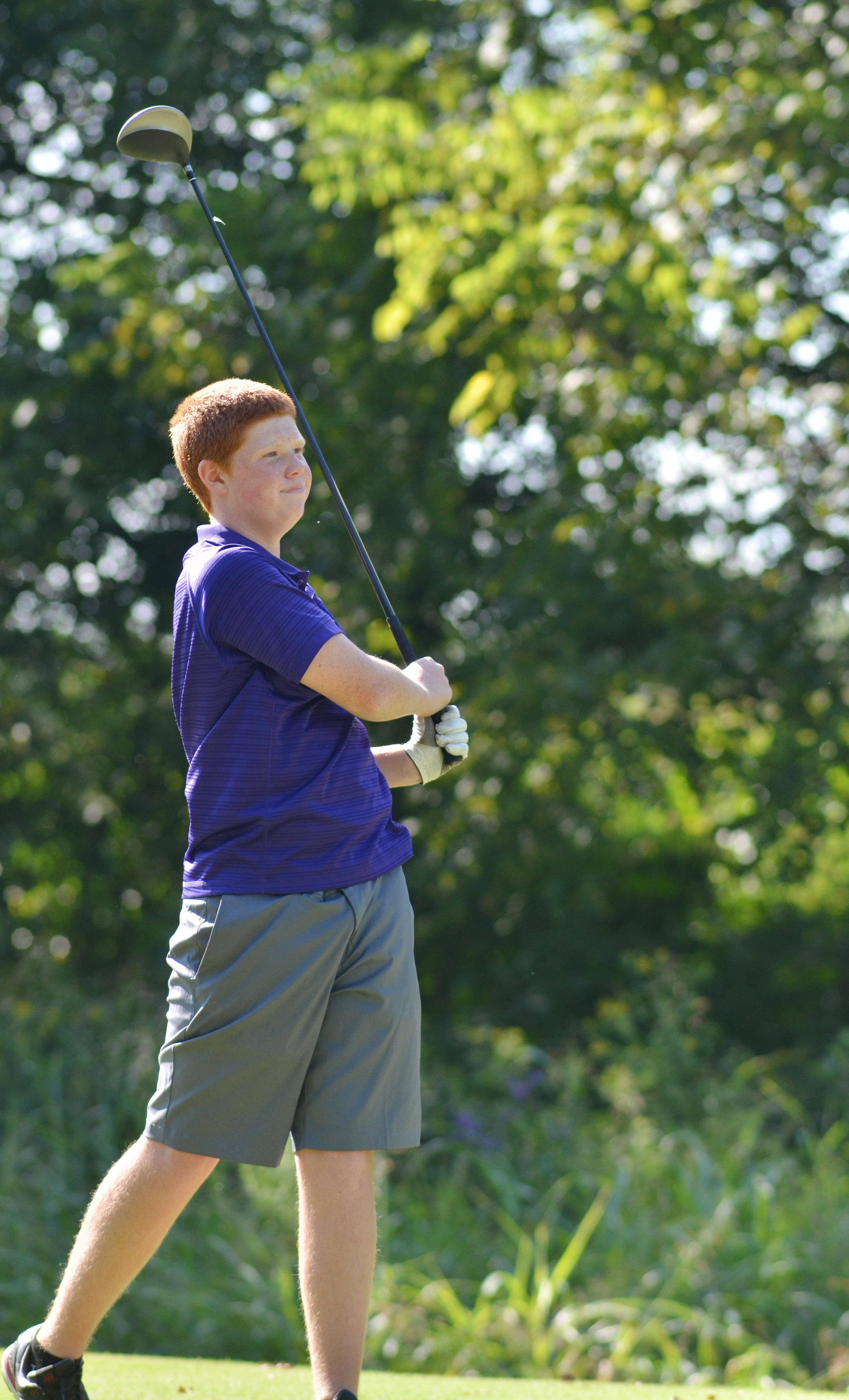 CHS freshman Colin Harris watches to see where his ball lands.