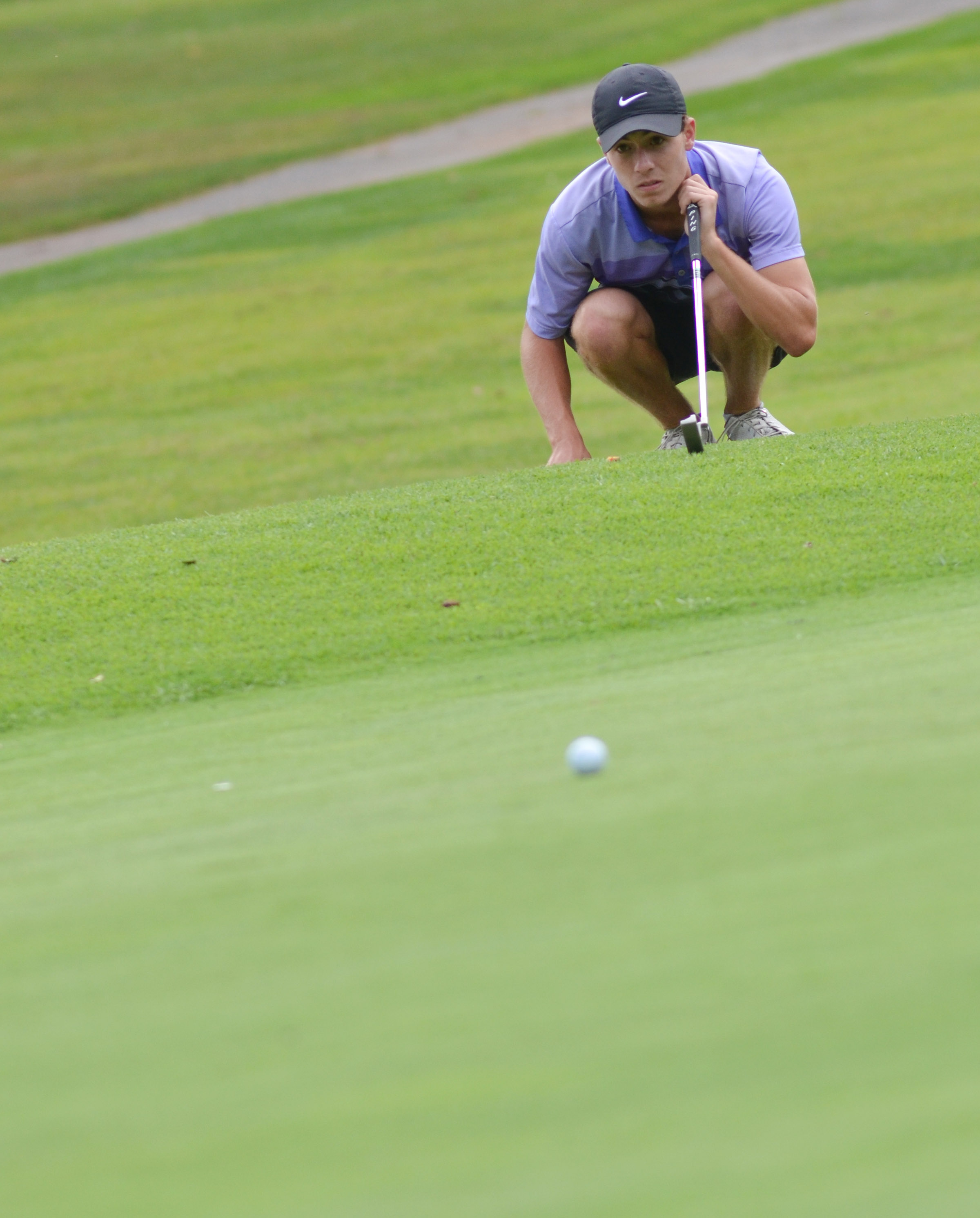CHS junior Layton Hord lines up a putt.