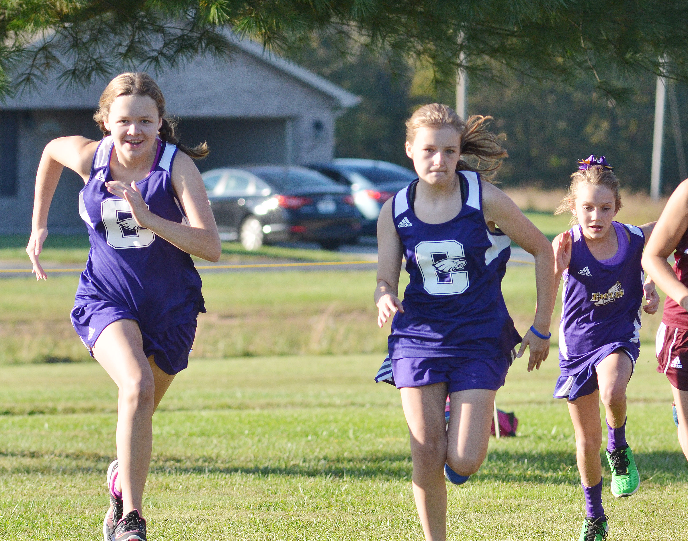 From left, CMS seventh-grader MaCayla Falls, eighth-grader Serenity Ford and CES third-grader Baylee Pike run.