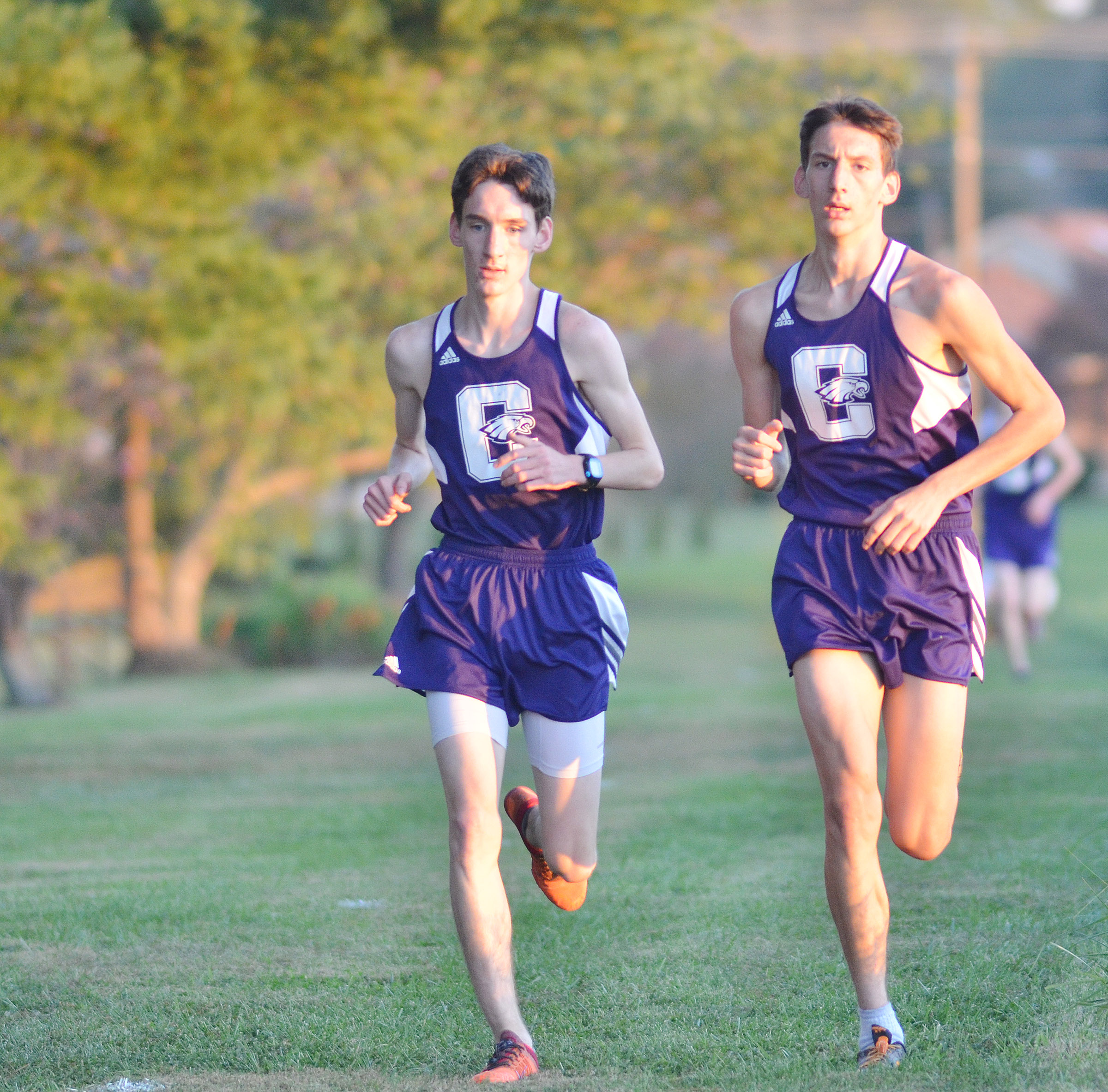 CHS juniors Ian McAninch, at left, and Evan McAninch run.