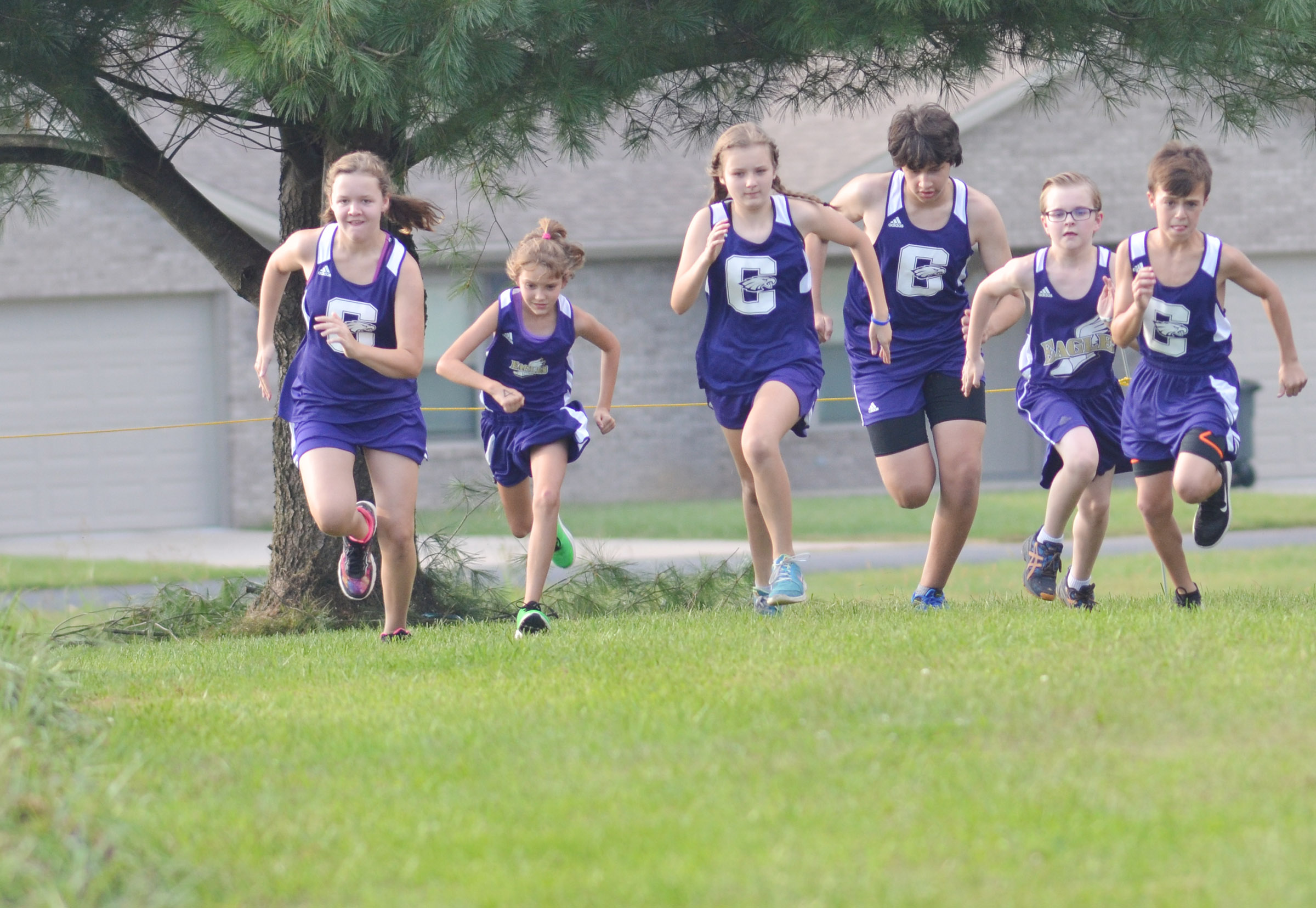 Cross country runners compete in the middle school race.