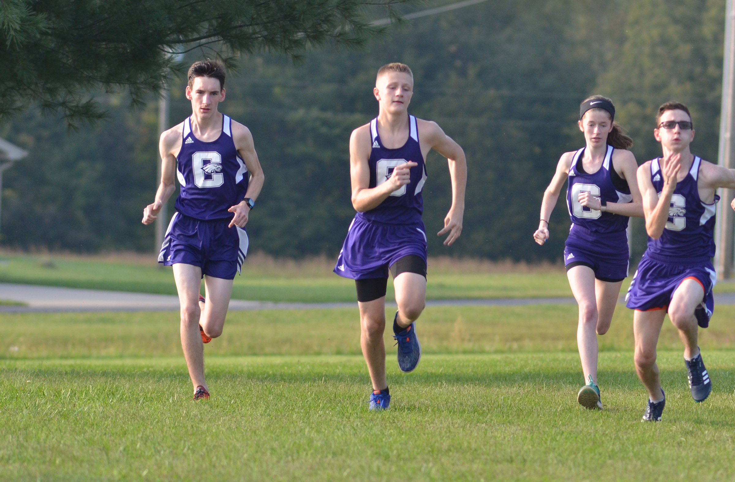 CHS cross country runners start their race.