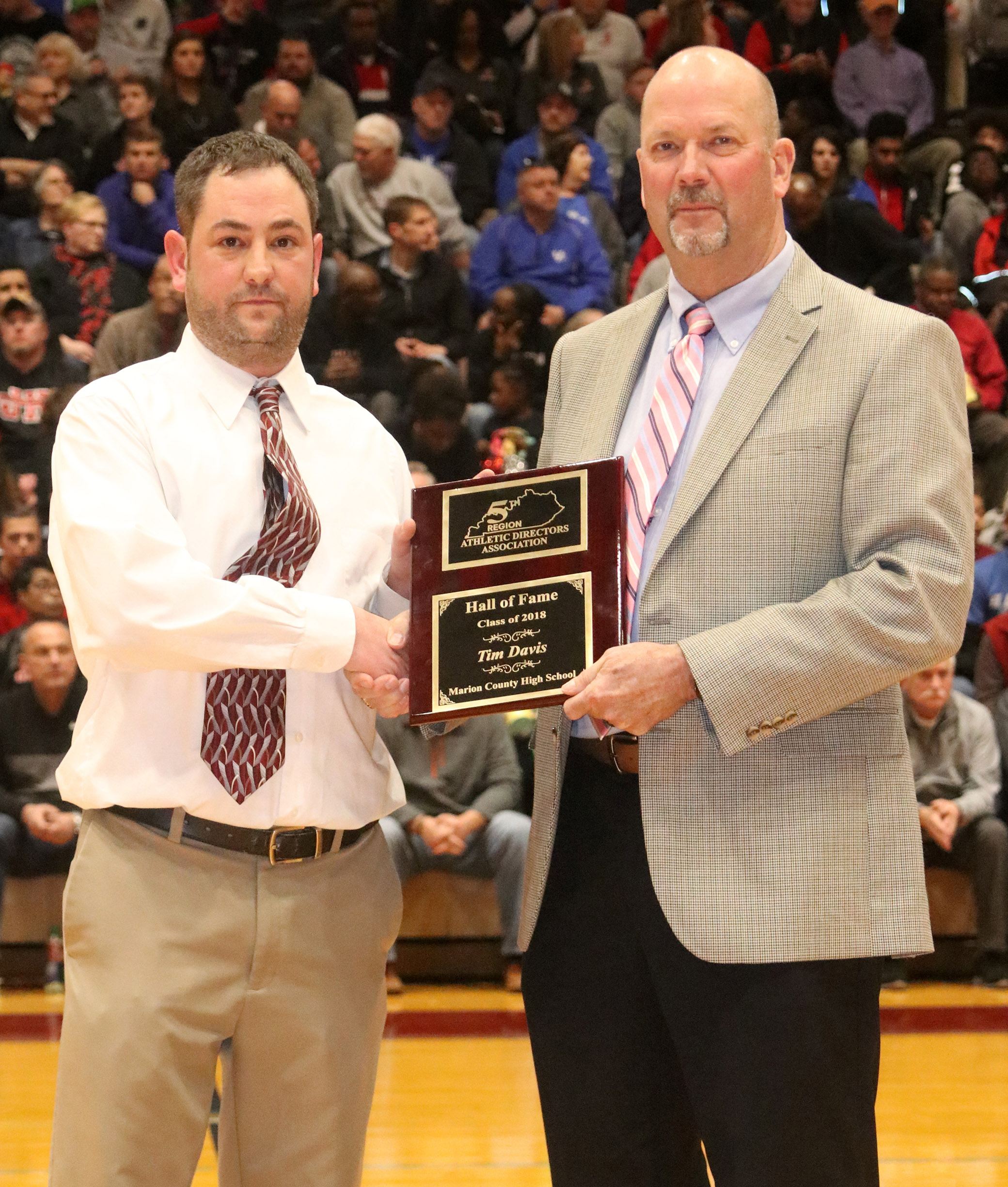 CHS boys' basketball head coach Tim Davis, at right, was induced into the 5th Region Athletic Director's Hall of Fame in a special ceremony at Marion County High School on Tuesday, March 6. Michael Holt, athletic director at Marion County, made the presentation.