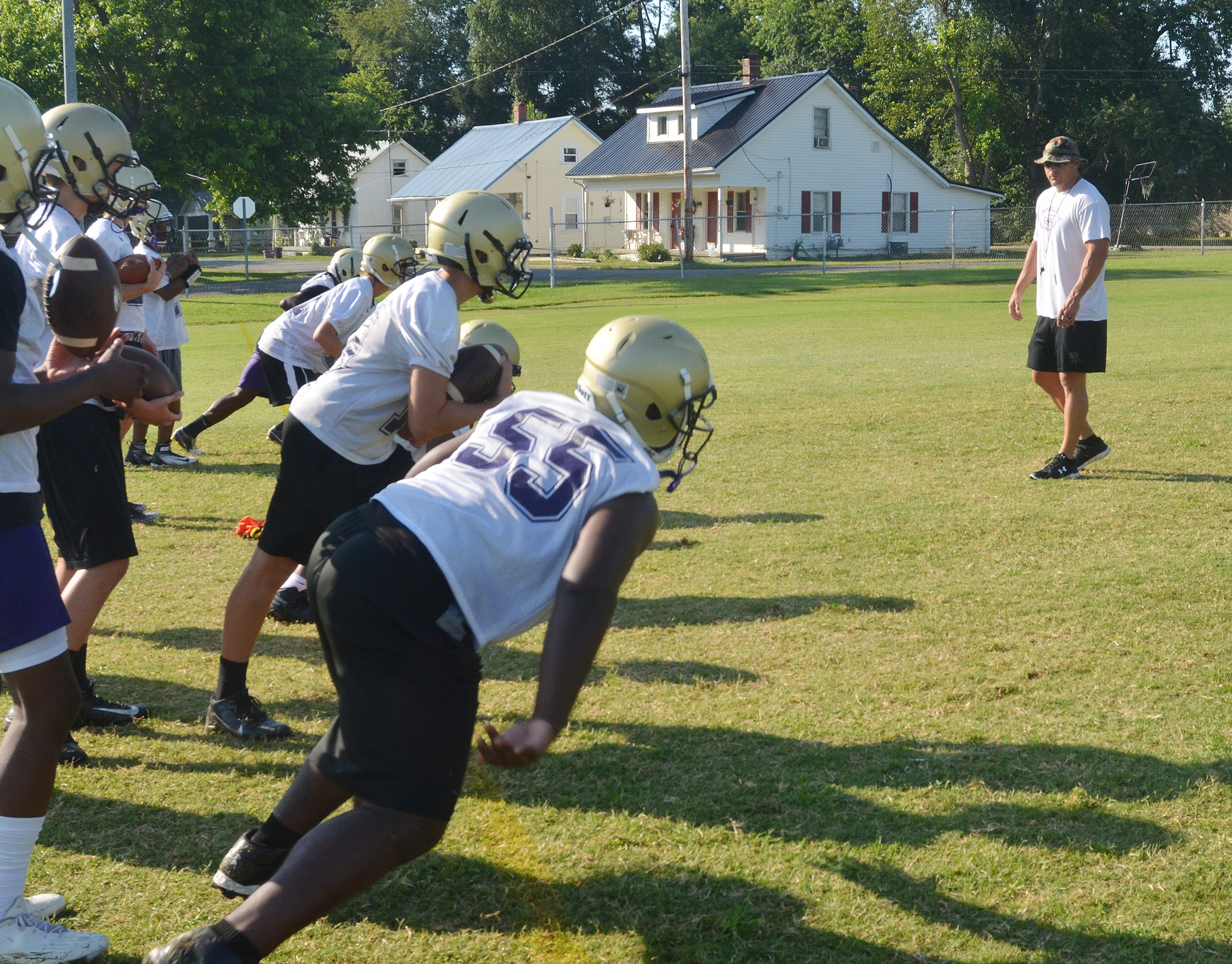 CHS assistant football coach Robbie Gribbins runs a drill during practice.