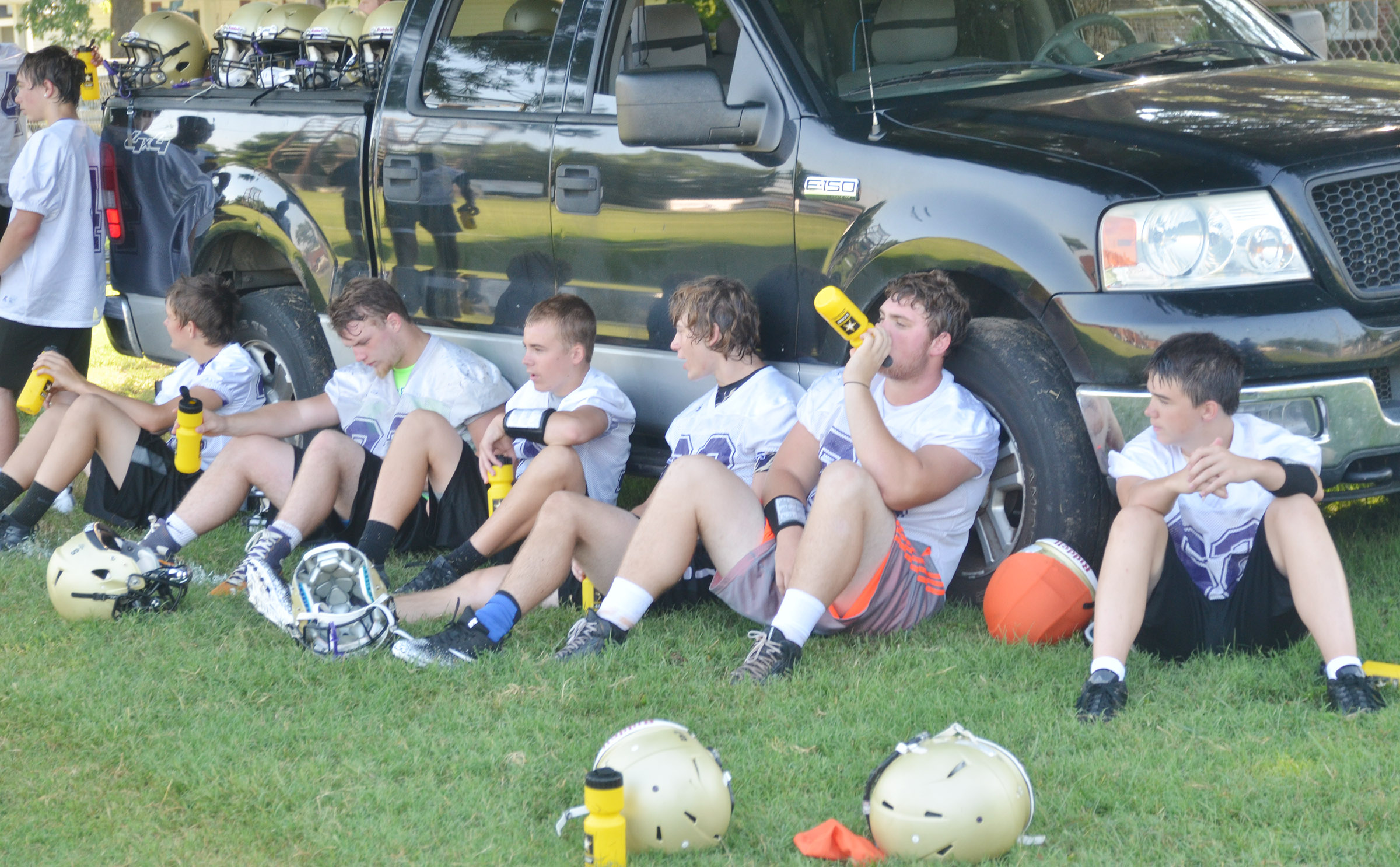 CHS football players take a break during practice.