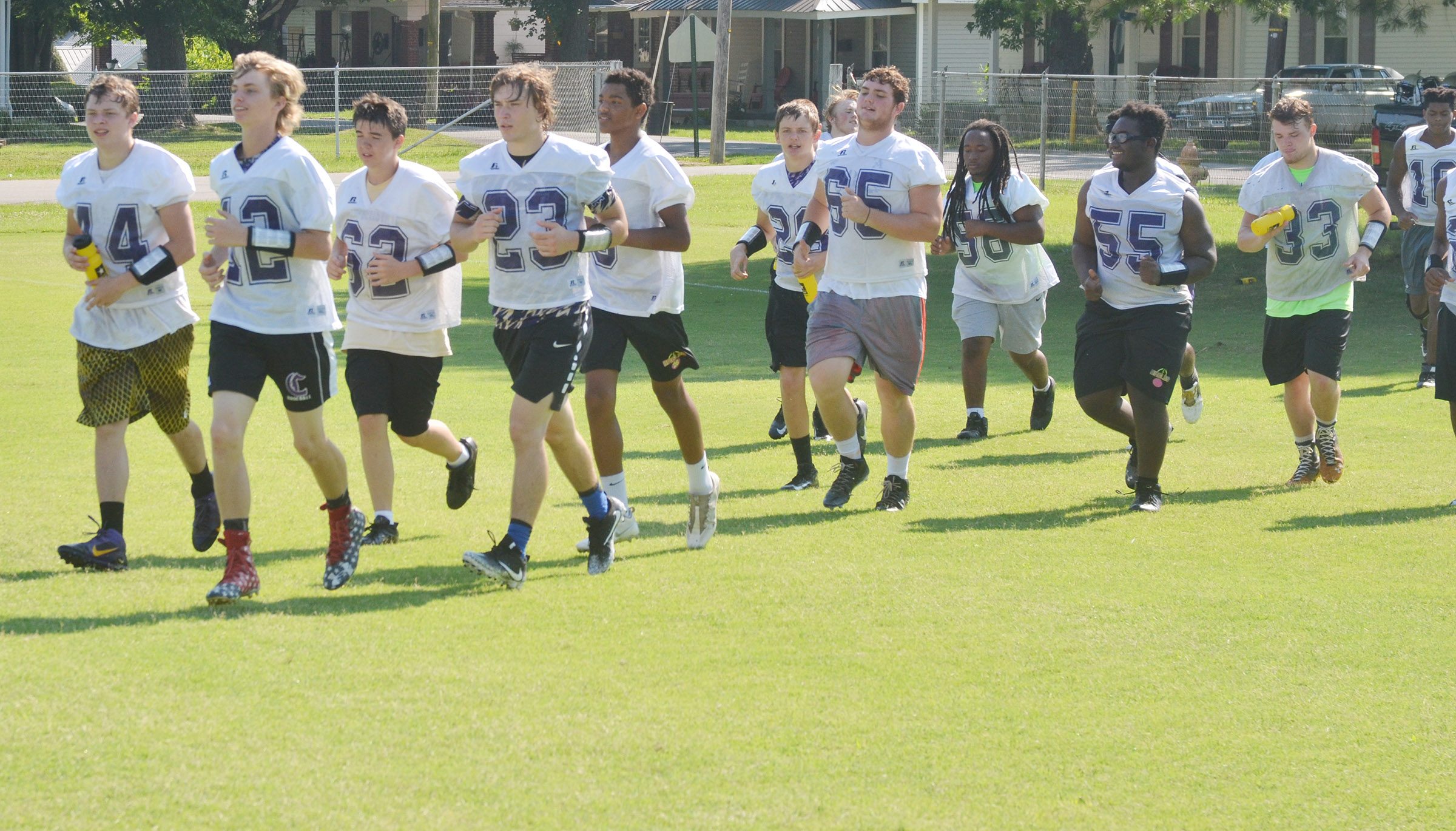 CHS football players run during practice.