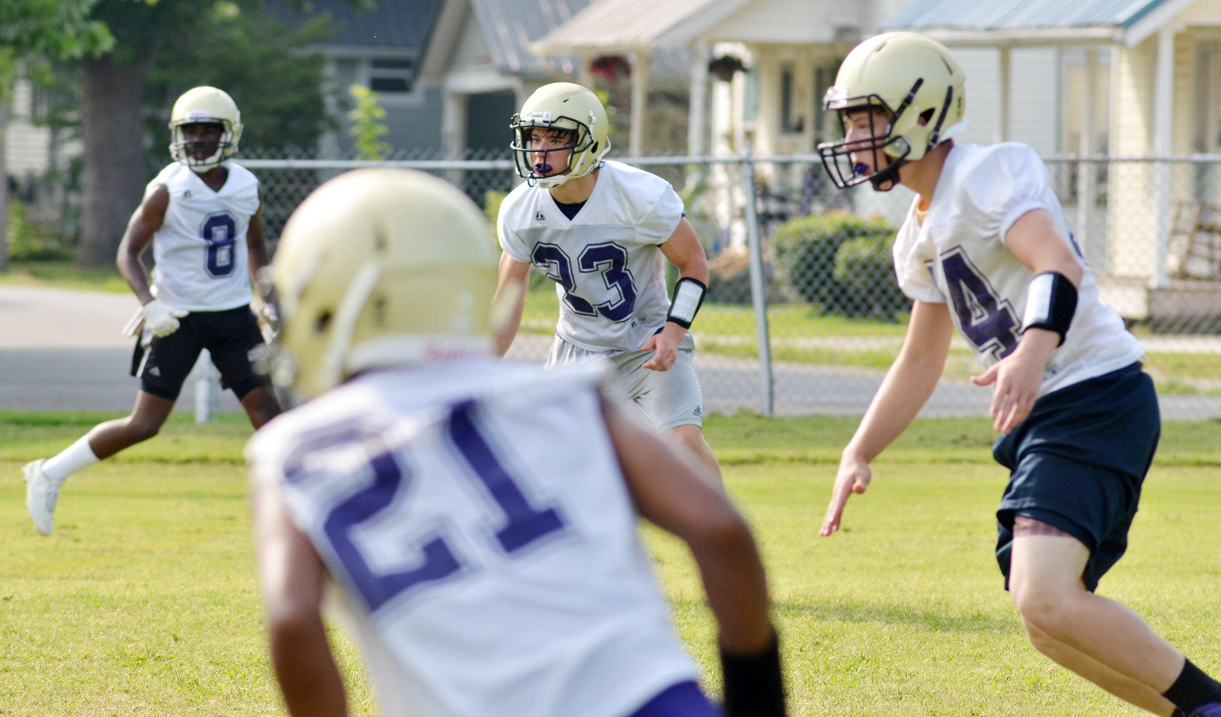 From left, CHS sophomore Malachi Corley and juniors Tristan Johnson and Dakota Reardon run a play.