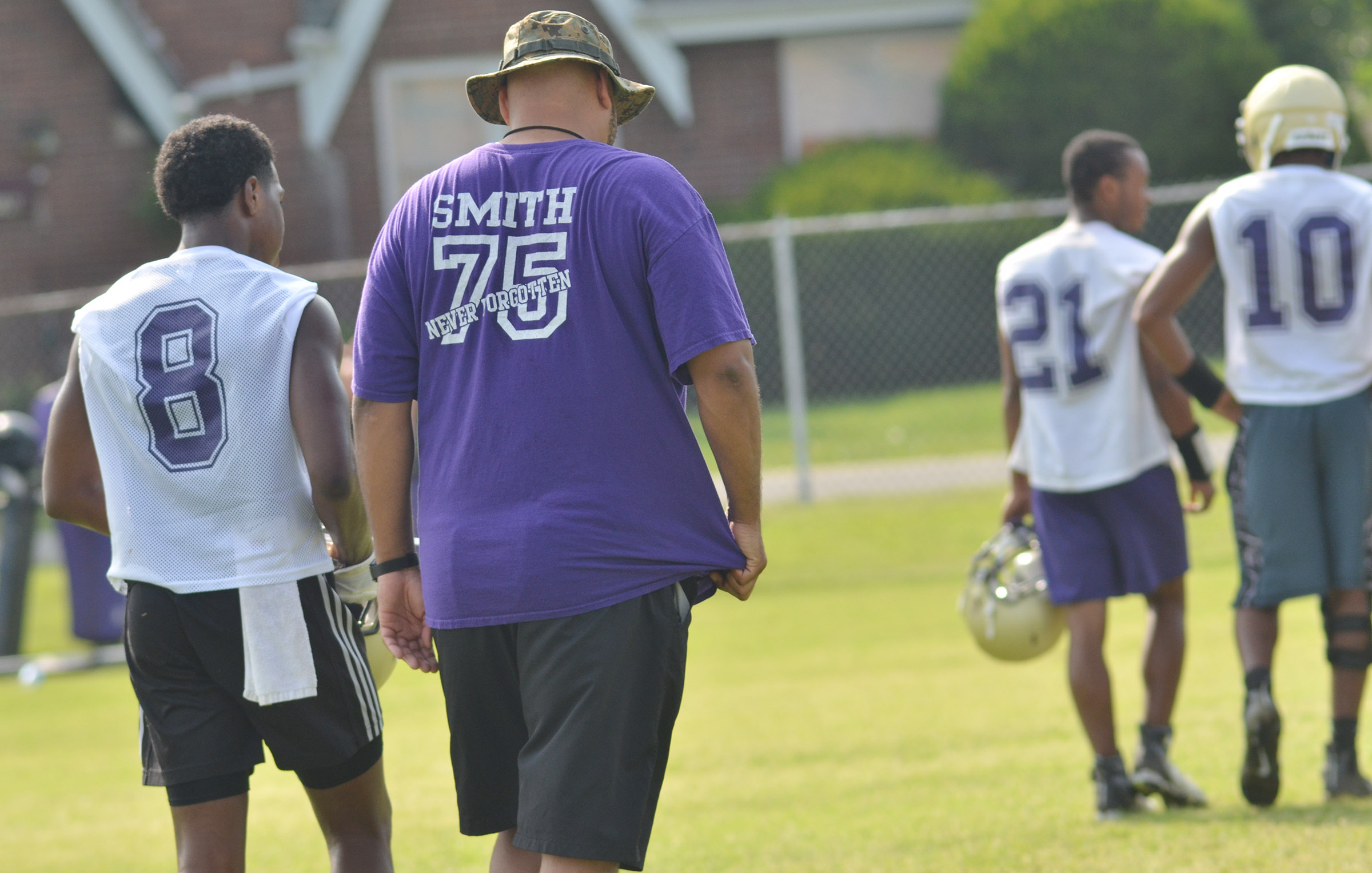 CHS sophomore Malachi Corley talks to assistant coach Aaron Webb during practice.