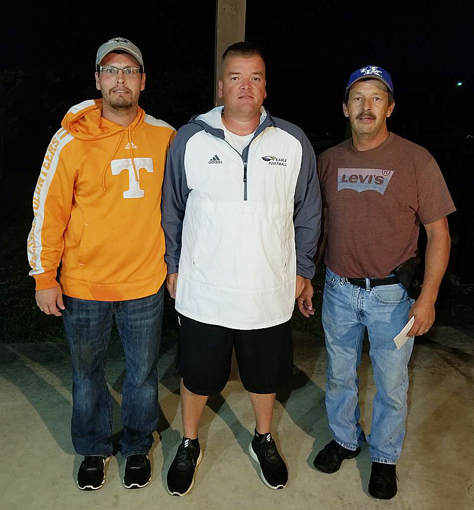 Billy Benningfield, at right, and Justin Benningfield, at left, won second place in the first CHS football bass tournament on Friday, Aug. 4. They won a $300 prize. The Benningfields are pictured with CHS head football coach Dale Estes.