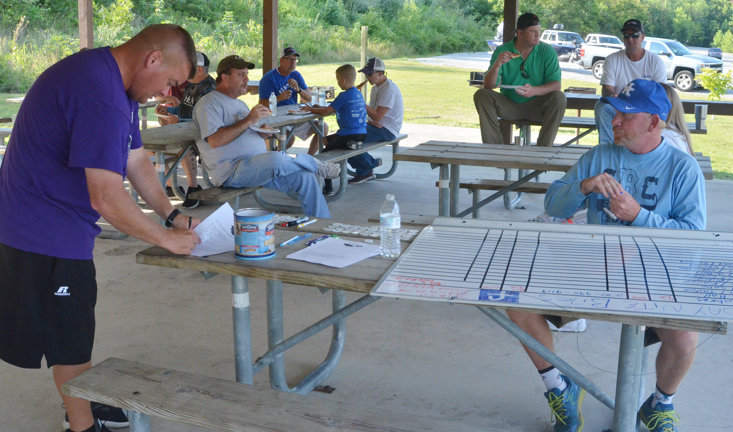 CHS head football coach Dale Estes registers participants in his team's first bass tournament.
