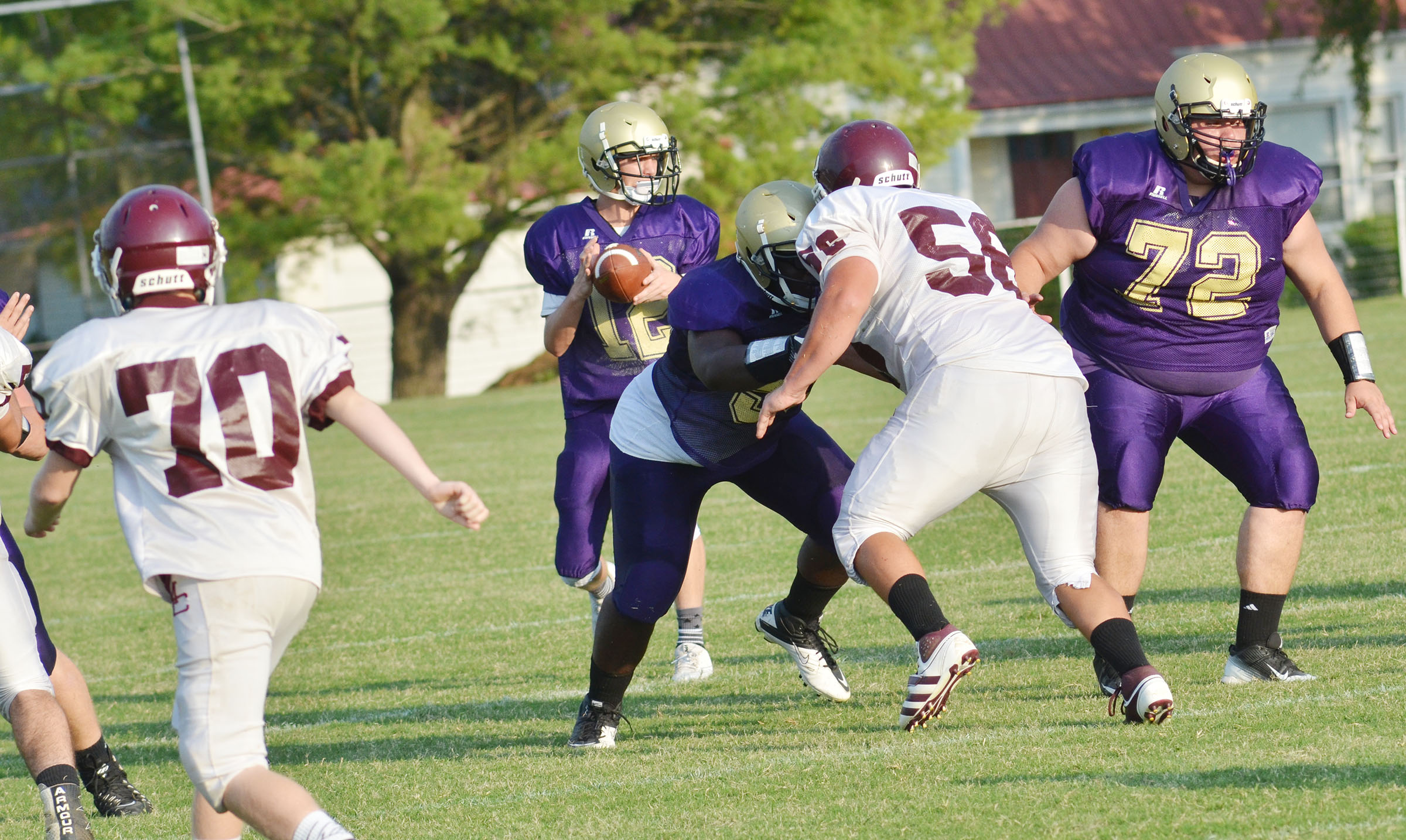 CHS sophomore Taekwon McCoy, center, and senior Ryan Wiedewitsch block for quarterback Arren Hash, a freshman.