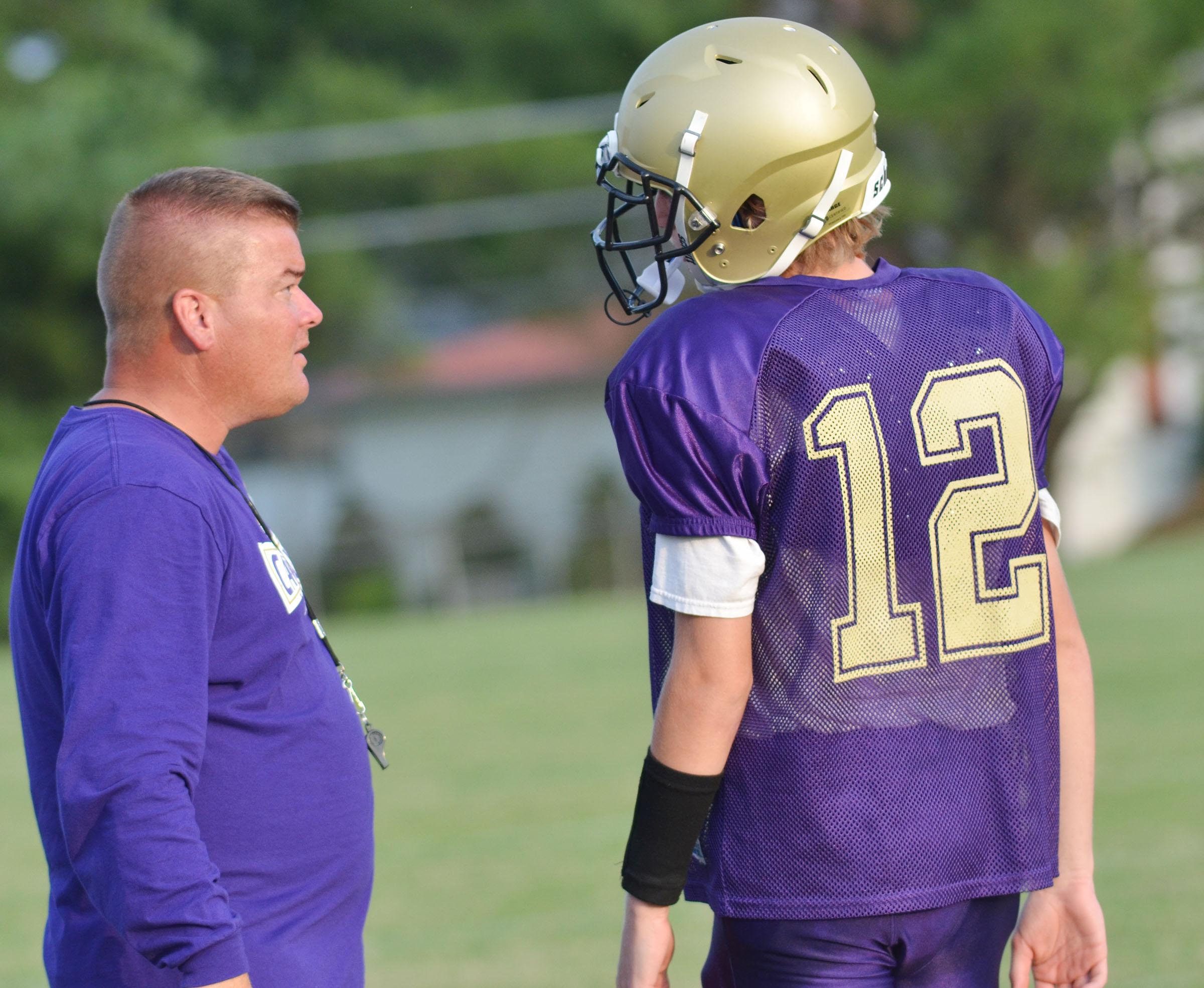 CHS head football coach Dale Estes talks to quarterback Arren Hash, a freshman.
