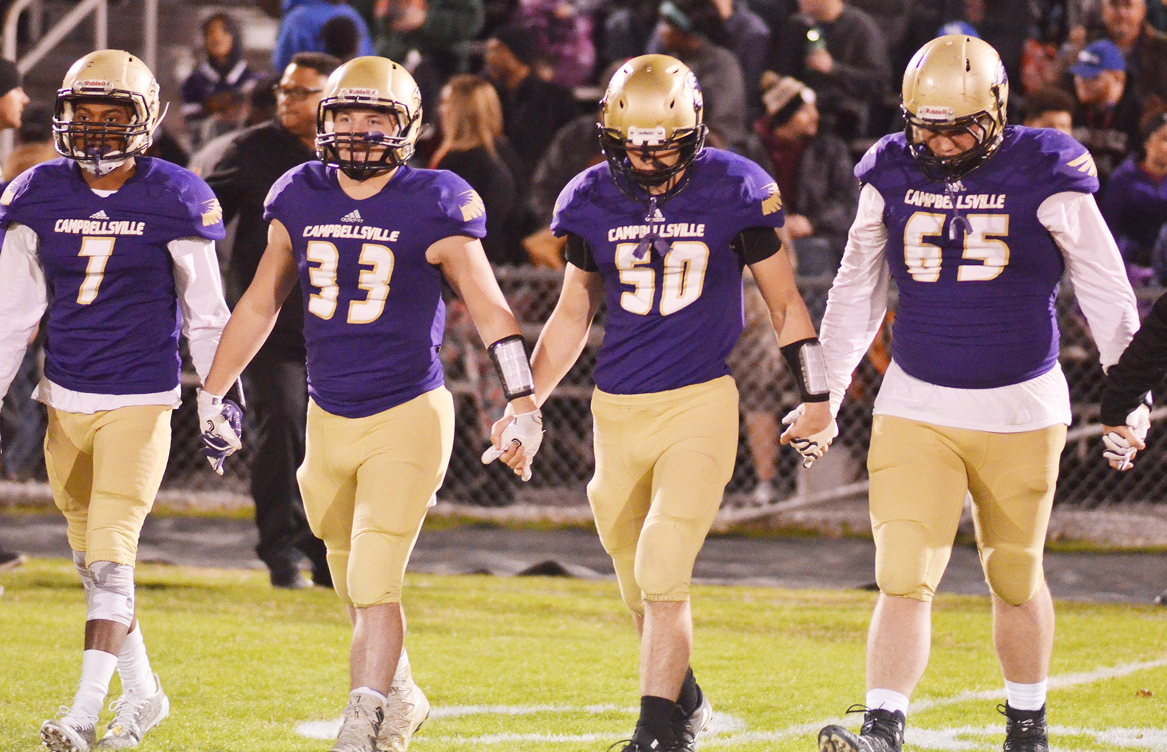 From left, CHS senior Devonte Cubit and juniors Dakota Reardon, Tristan Johnson and Lane Bottoms walk to the coin toss.