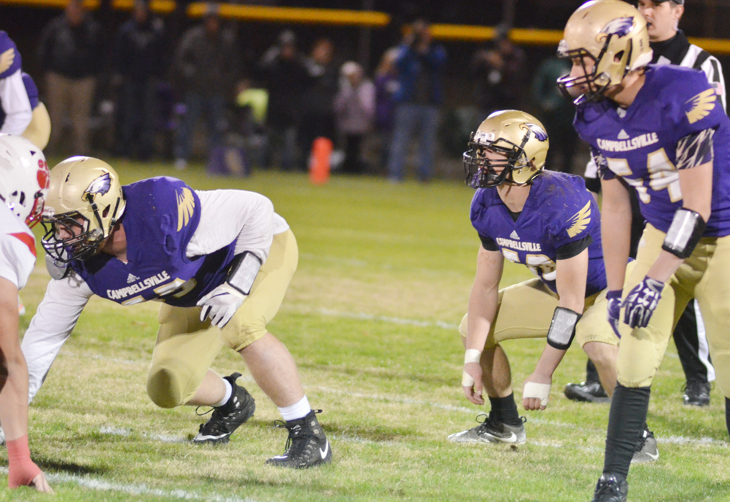 From left, CHS juniors Lane Bottoms and Tristan Johnson and sophomore Devon Reardon get ready to tackle.