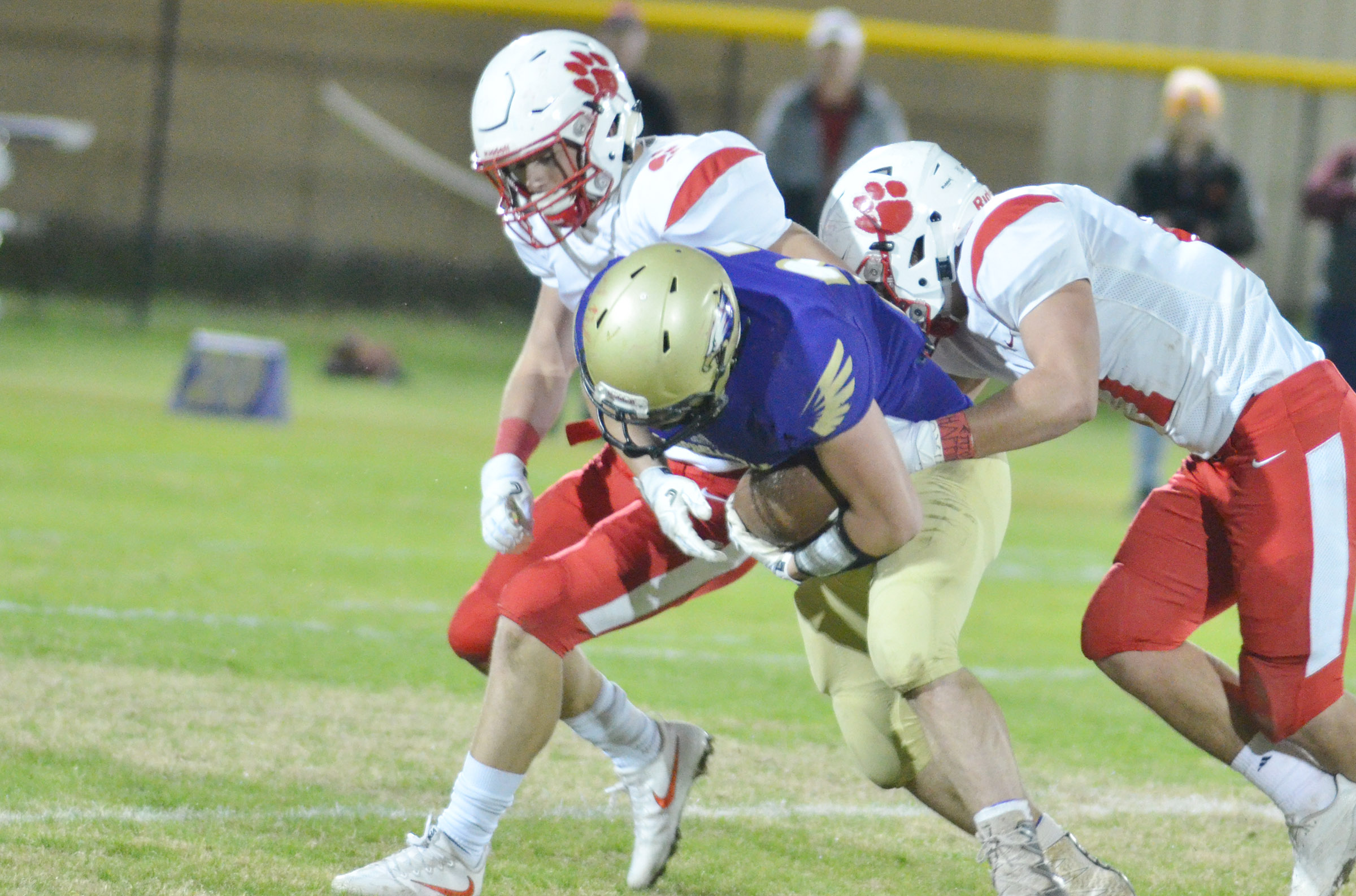 CHS junior Dakota Reardon is tackled after catching the ball.