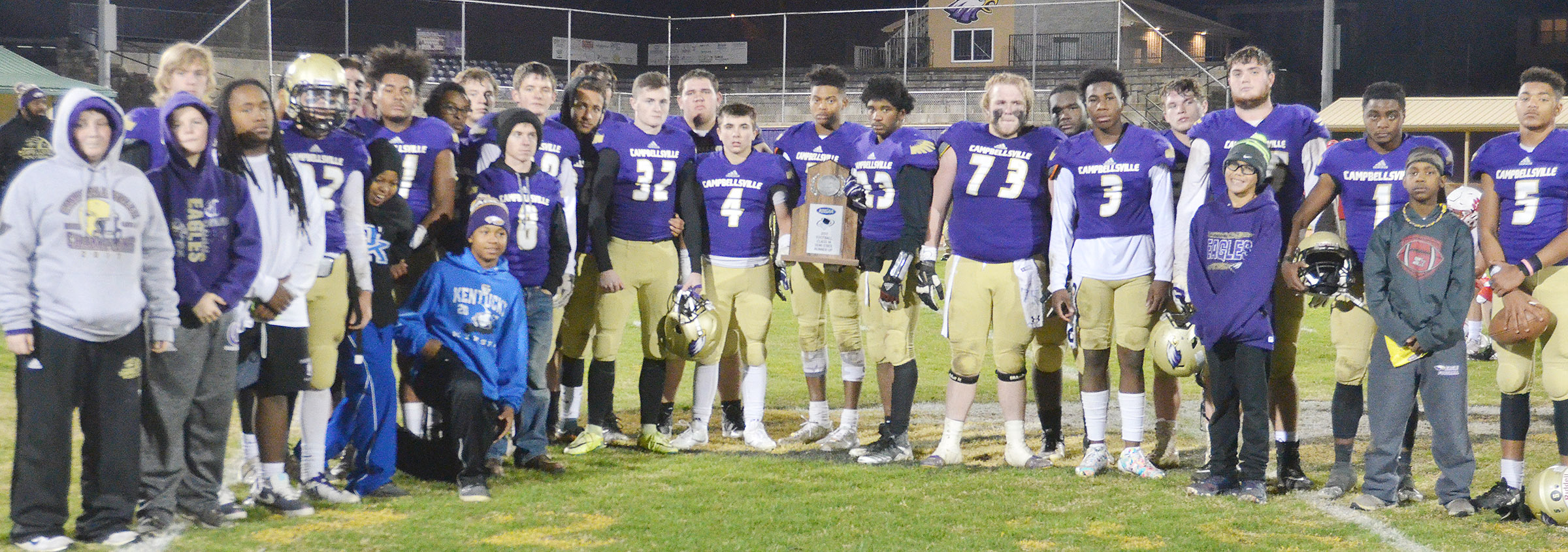 CHS football players receive their semi-finals runner-up trophy.