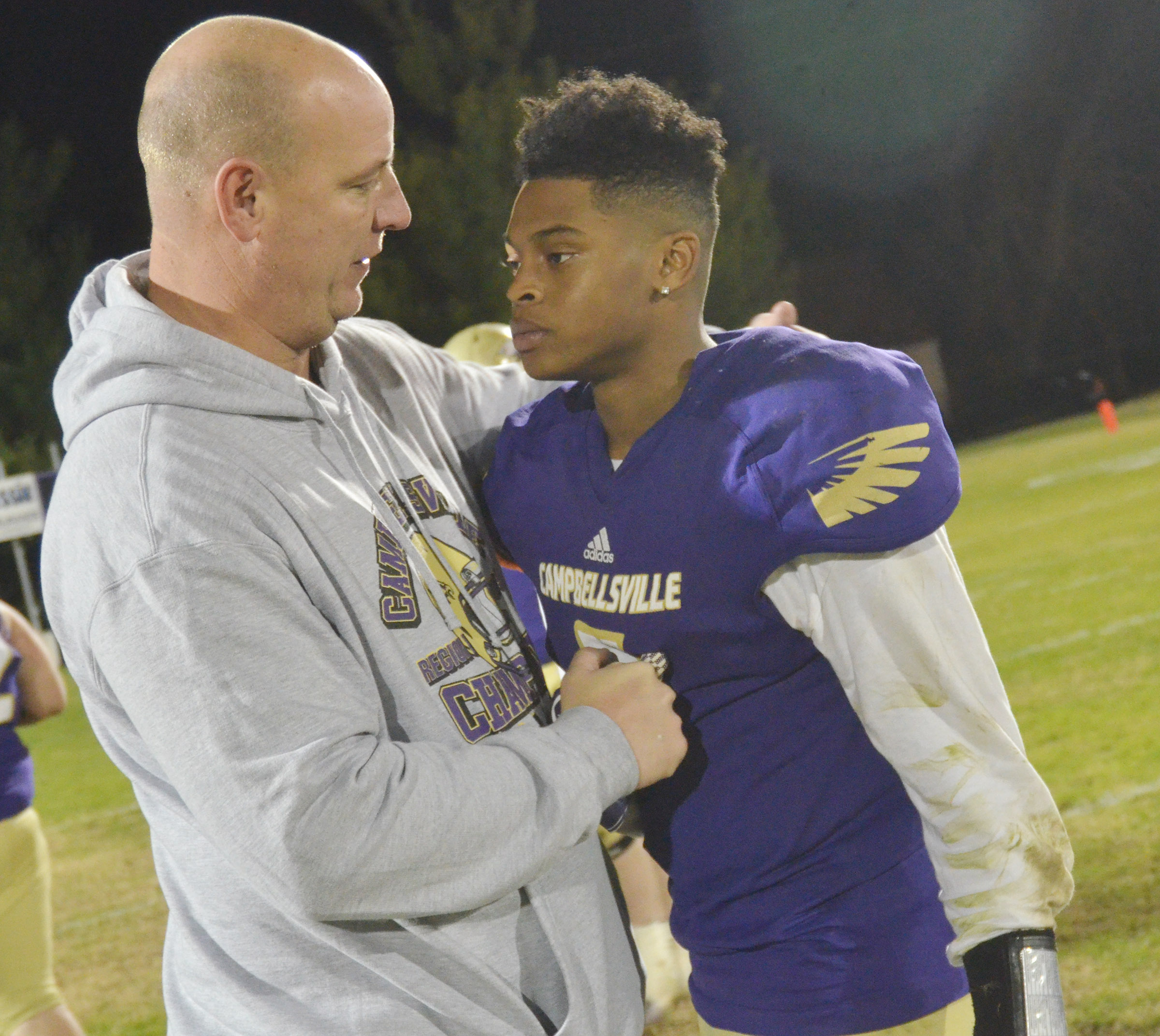 CHS Principal David Petett talks to senior Devonte Cubit after the game.