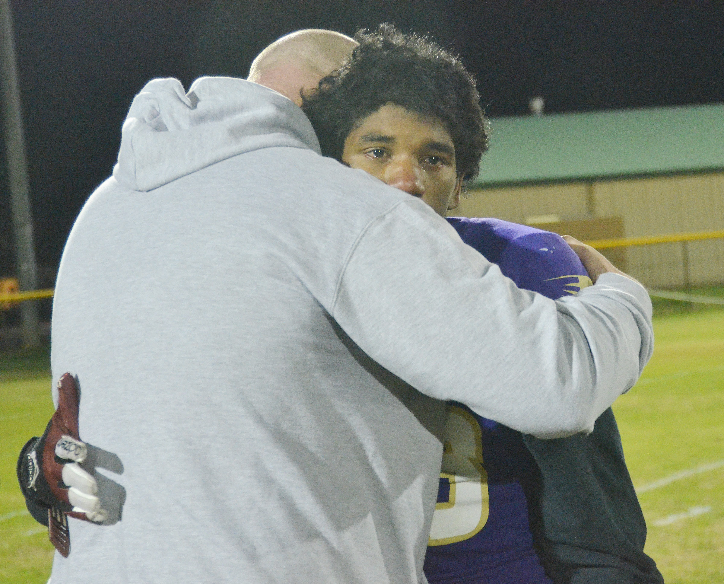 CHS Principal David Petett hugs senior Tyrion Taylor after the game.