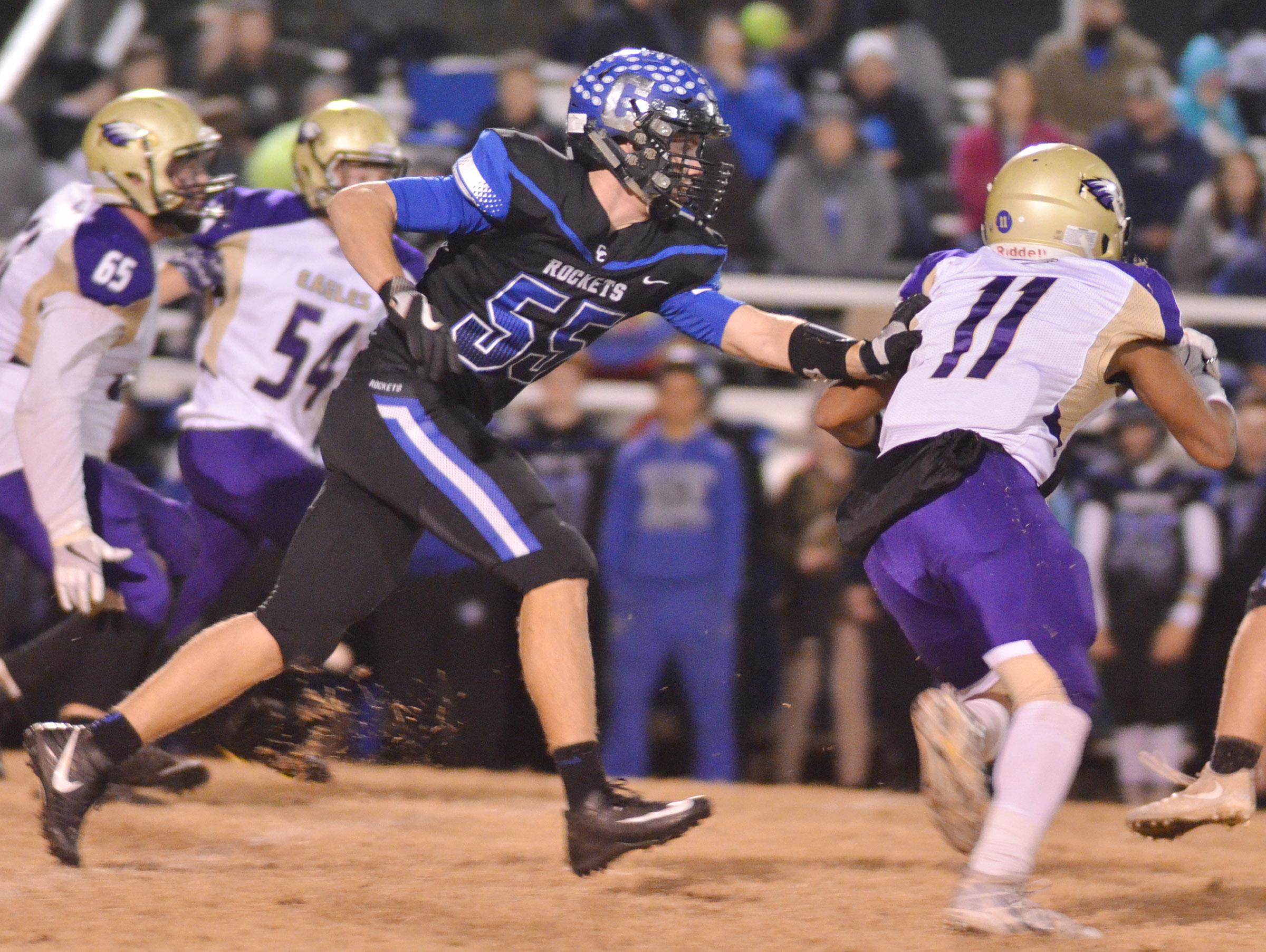CHS sophomore Braden Paige runs from a Crittenden County defender.