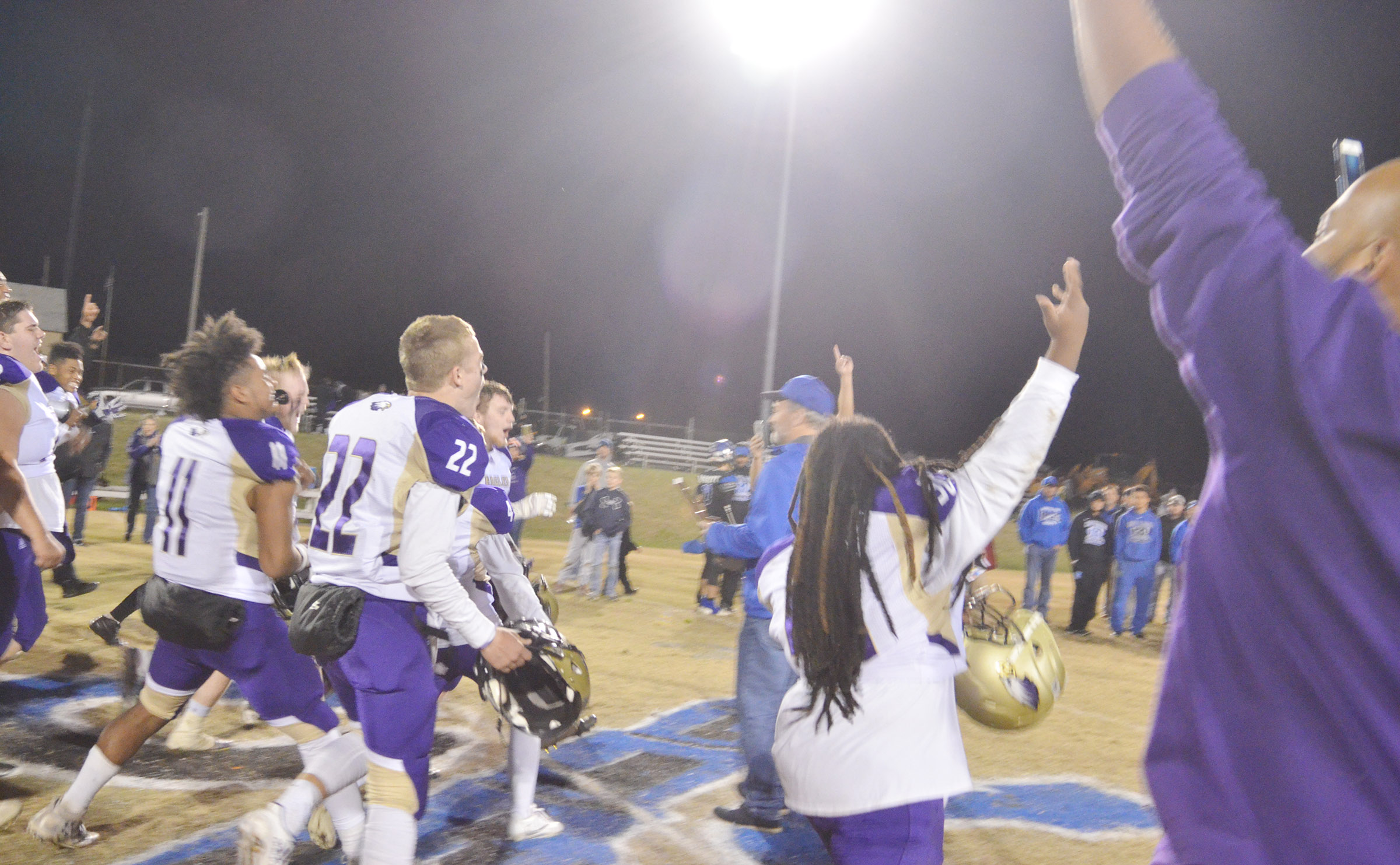 CHS football players celebrate.