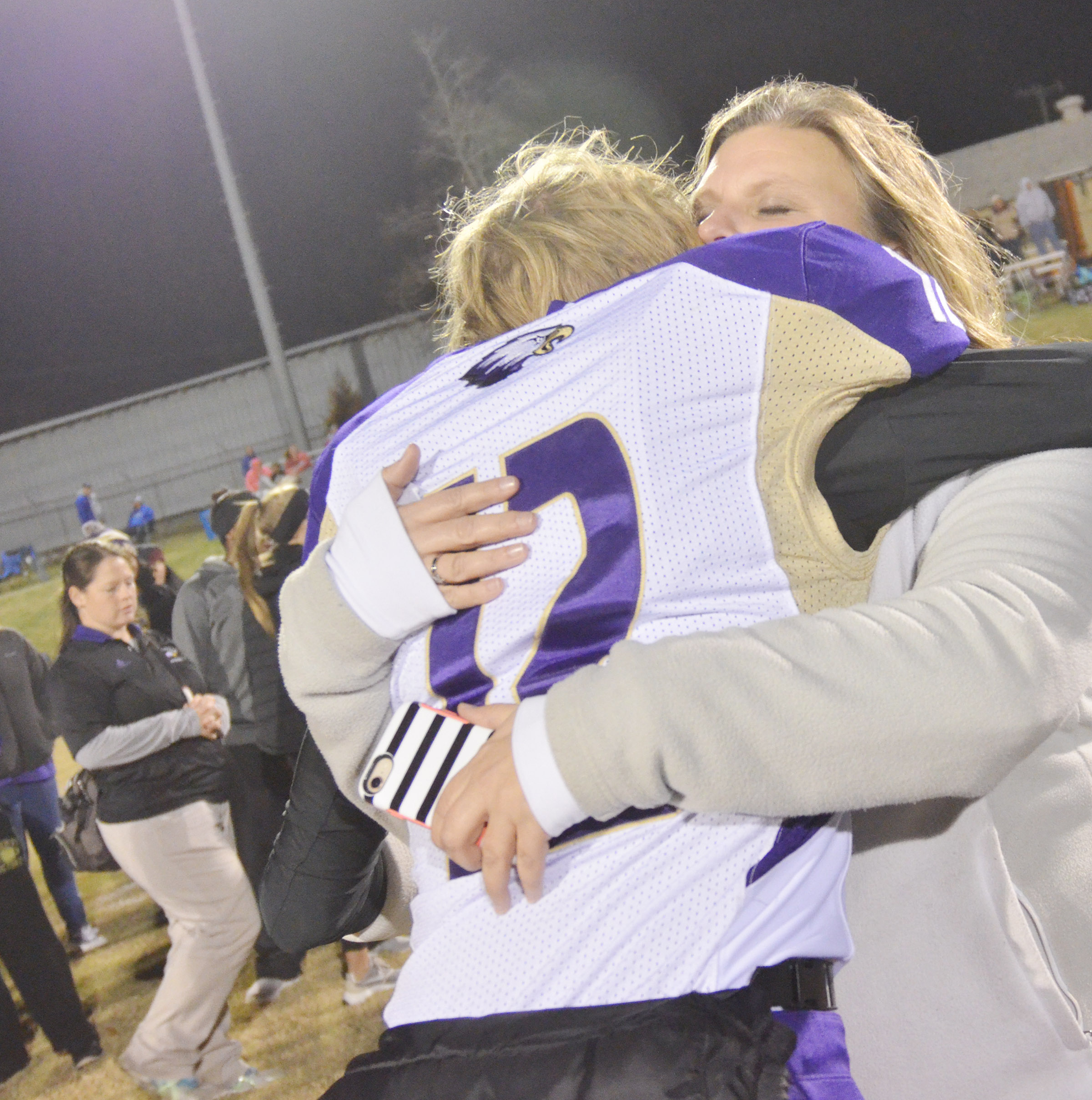 CHS freshman Arren Hash hugs his mother, Tammy, a teacher at Campbellsville Elementary School, after the game.