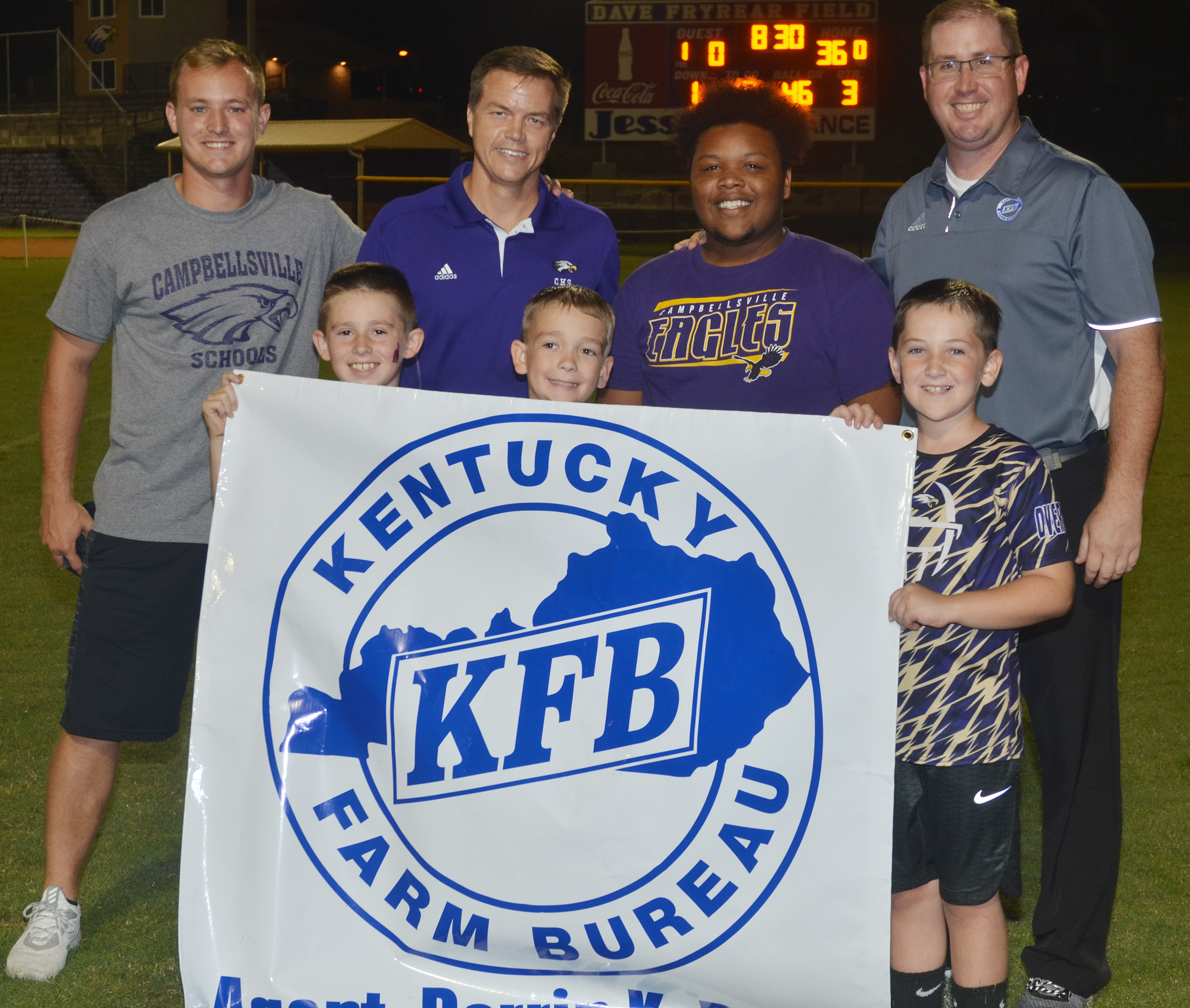 Kentucky Farm Bureau sponsors the Kick for Kids, which awards $50 for a successful field goal attempt during halftime. From left, front, are Campbellsville Elementary School third-grader Lanigan Price, fourth-grader Cameron Estes and third-grader Luke Adkins. Back, CES AmeriCorps tutor Bradley Bates, Campbellsville Independent Schools Associate Superintendent and Finance Director Chris Kidwell, who made the field goal, CHS senior Darius Wright, who received $50 for Kidwell's successful kick, and Farm Bureau agent Darrin Price.