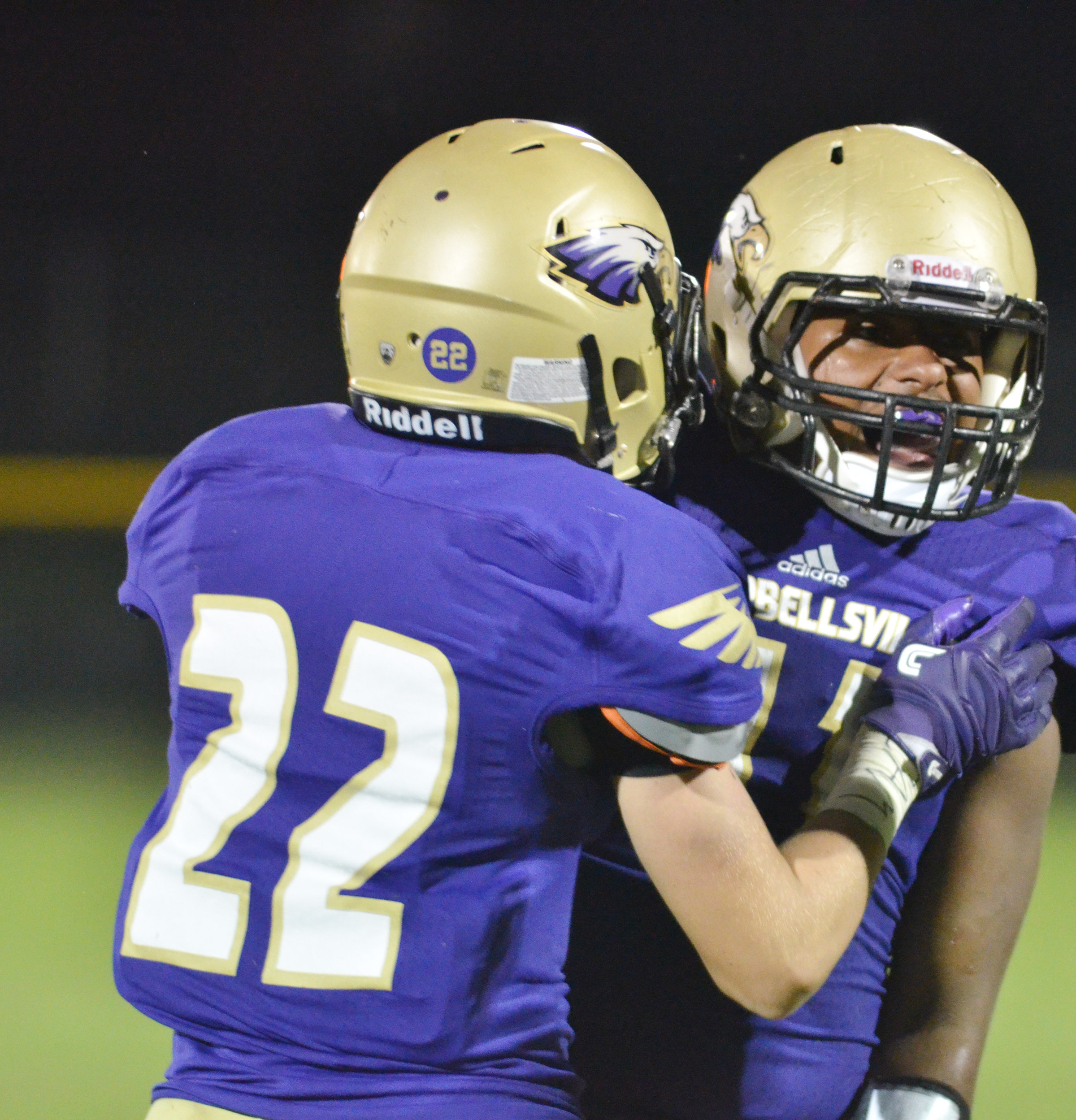 CHS sophomores Tyler Gribbins, at left, and Braden Paige celebrate a touchdown.