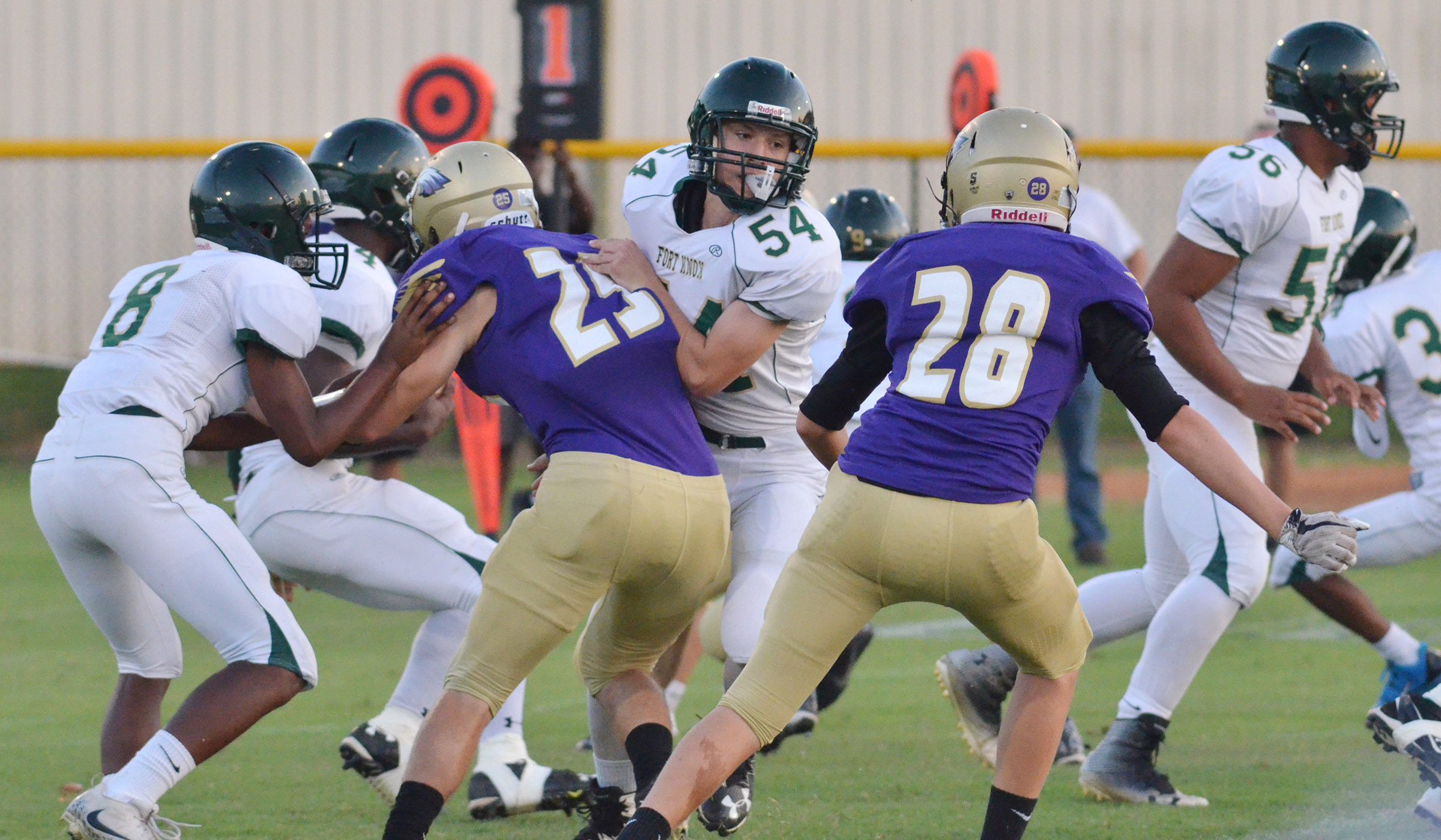CHS junior Tristan Johnson, at left, and sophomore Blake Allen tackle.