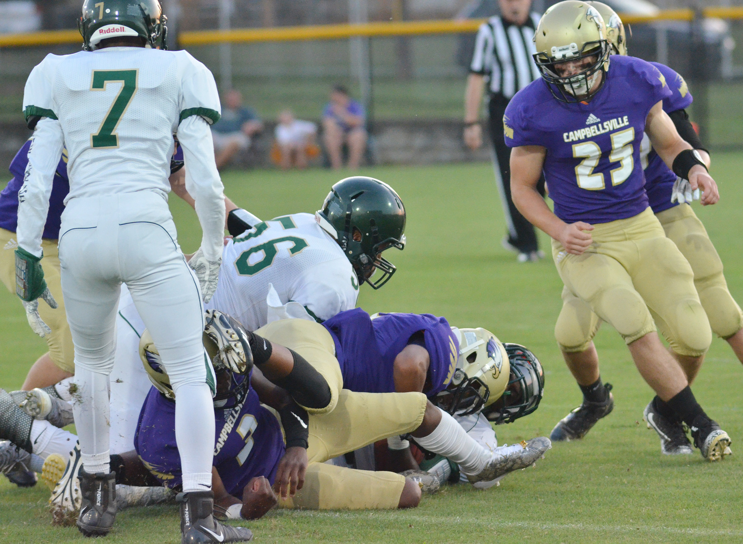 CHS junior Tristan Johnson and his teammates tackle.