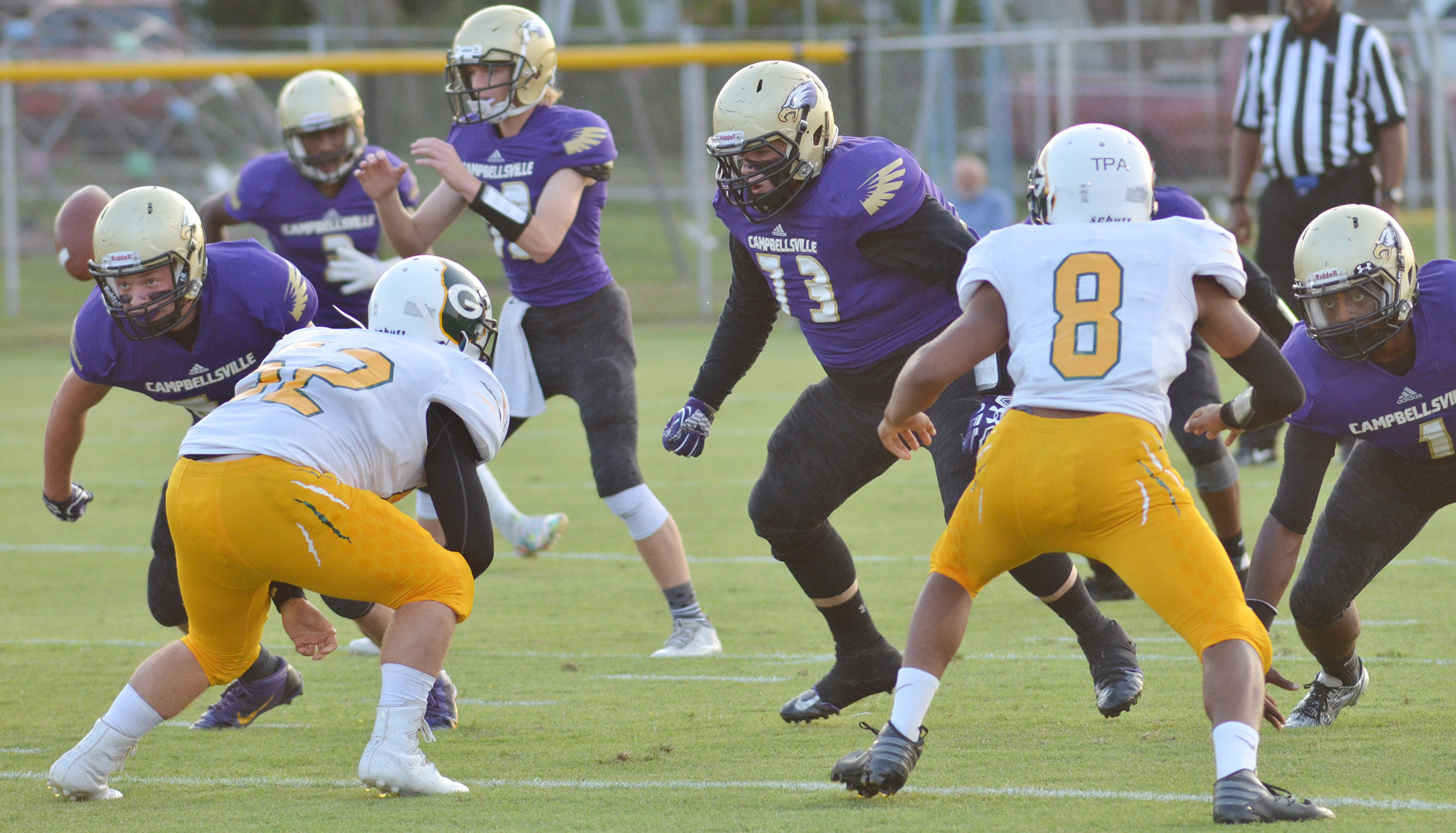 CHS senior Ryan Jeffries, center, tackles.