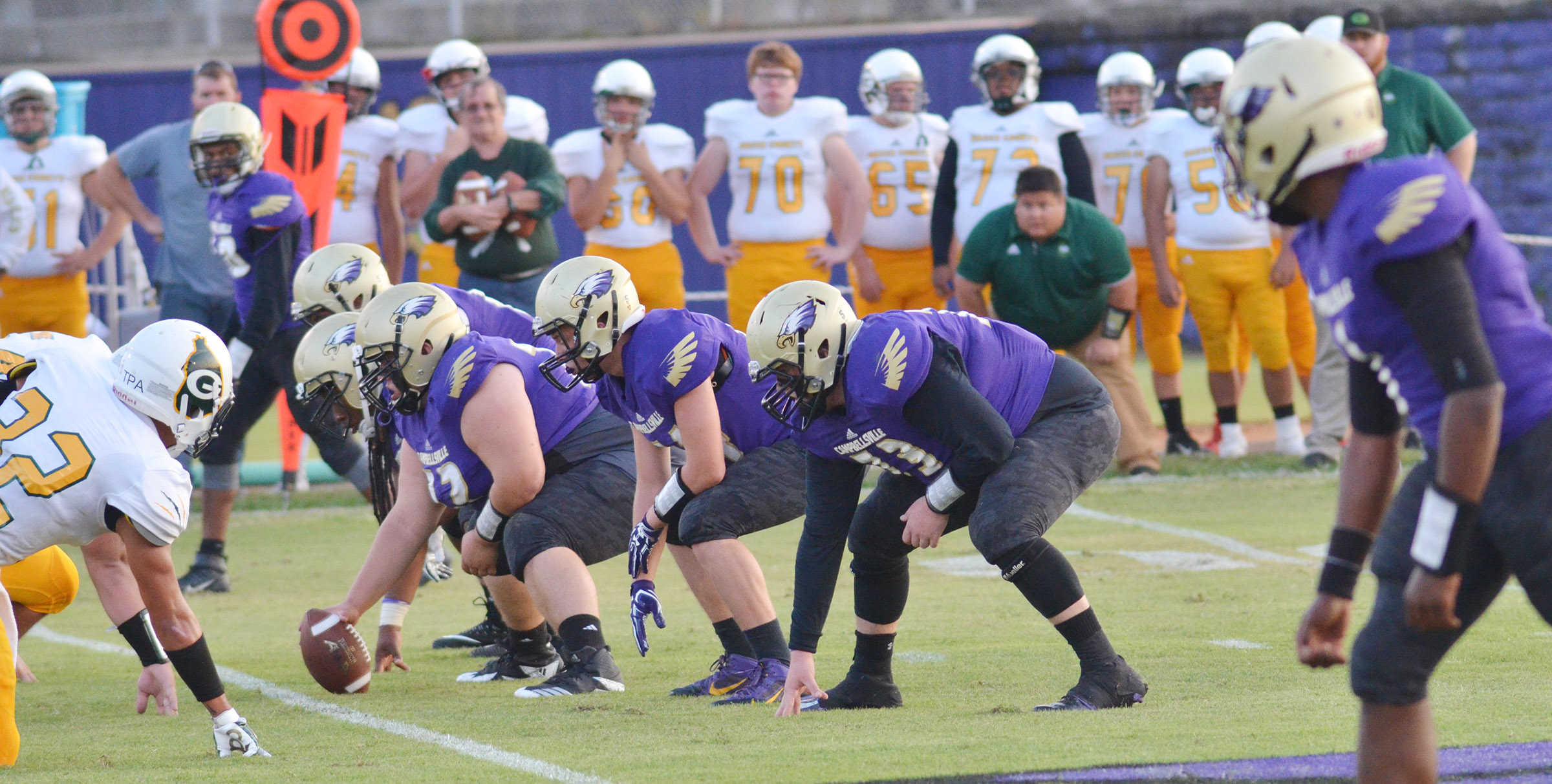 CHS offensive linemen get ready for the snap.