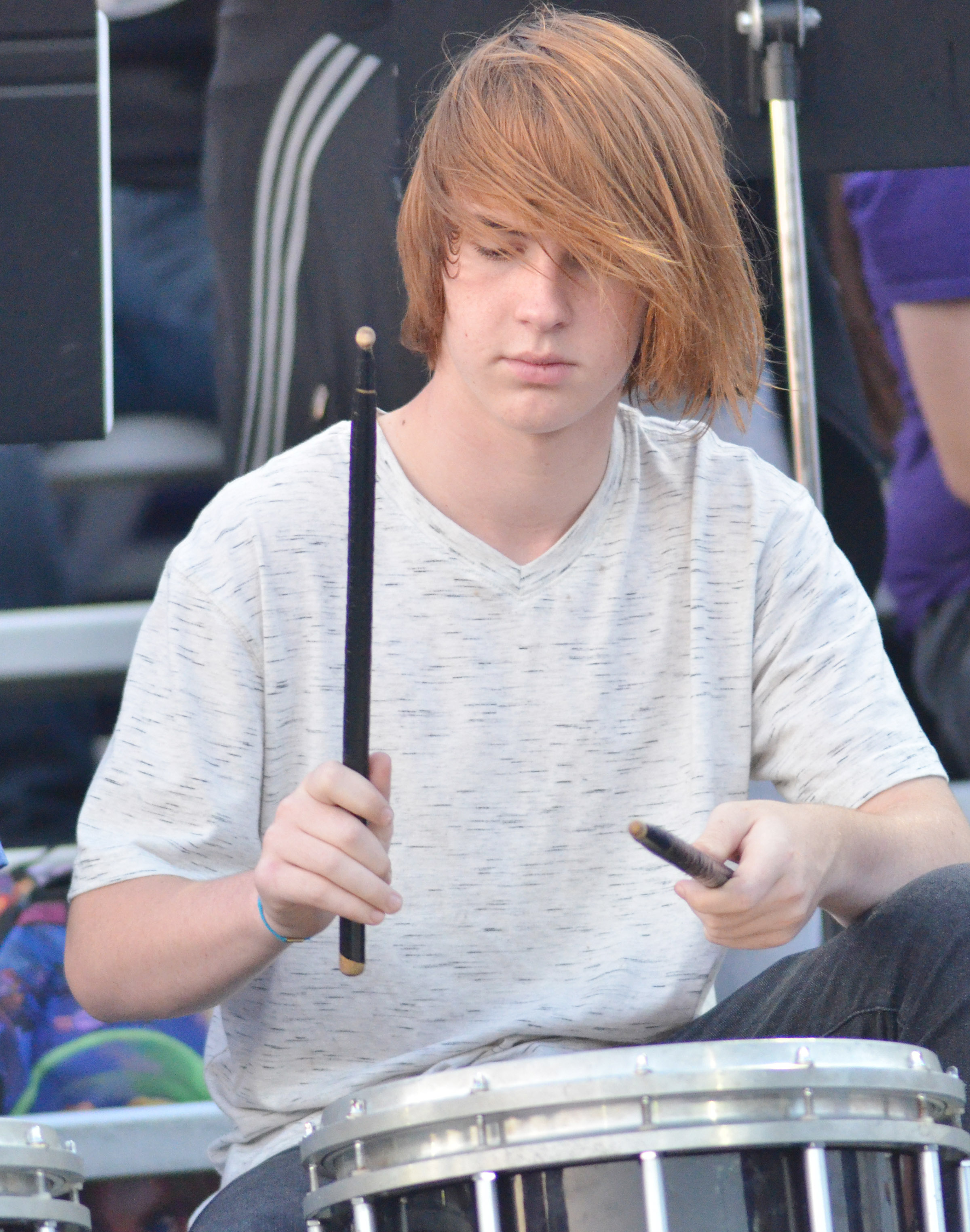 CHS junior Jason Agee plays drums with the pep band.