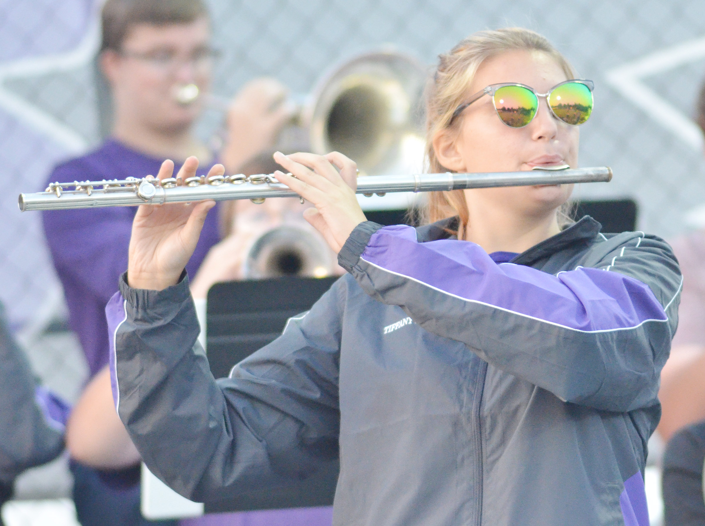 CHS senior Tiffany Kane plays flute with the pep band.