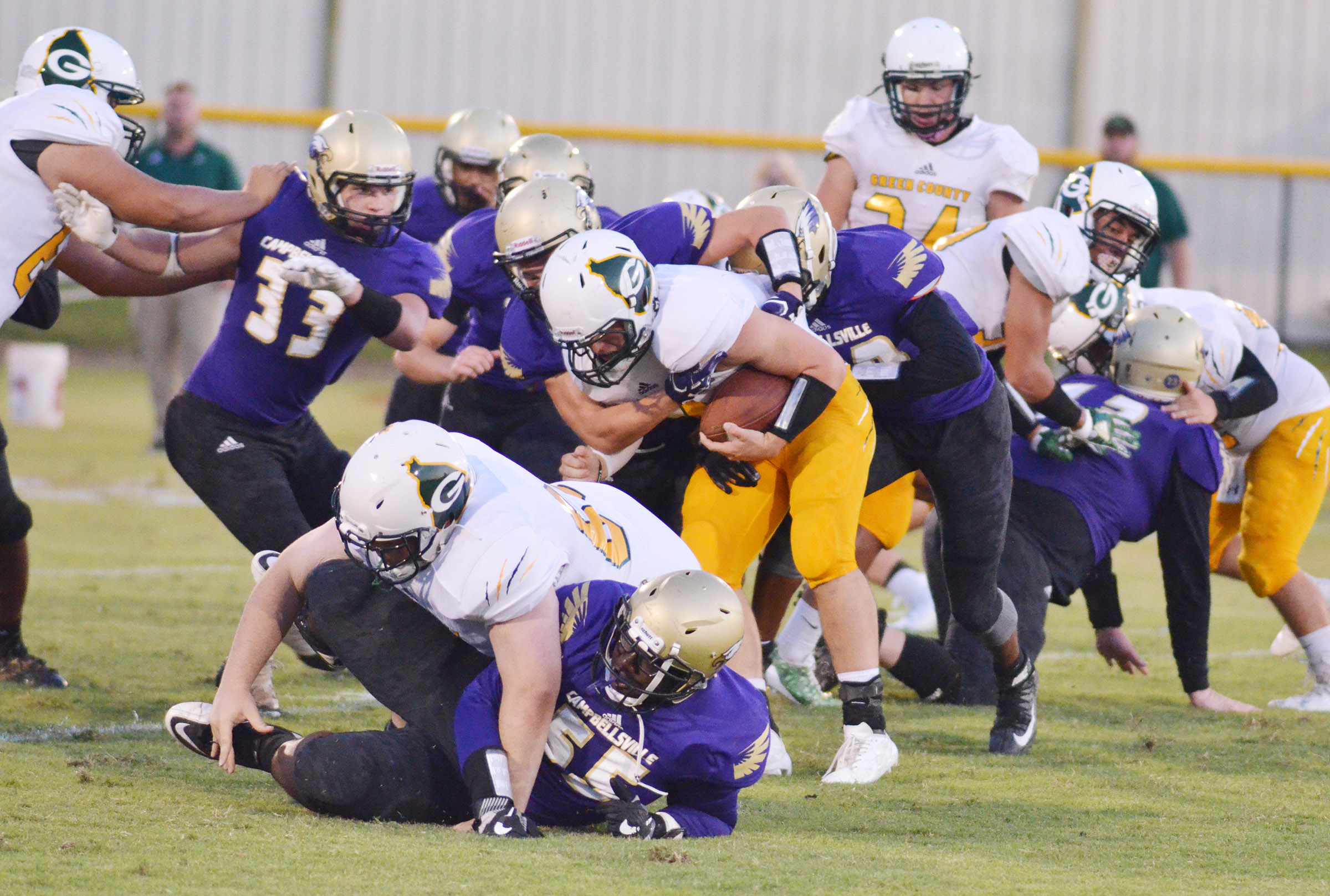 CHS players tackle.