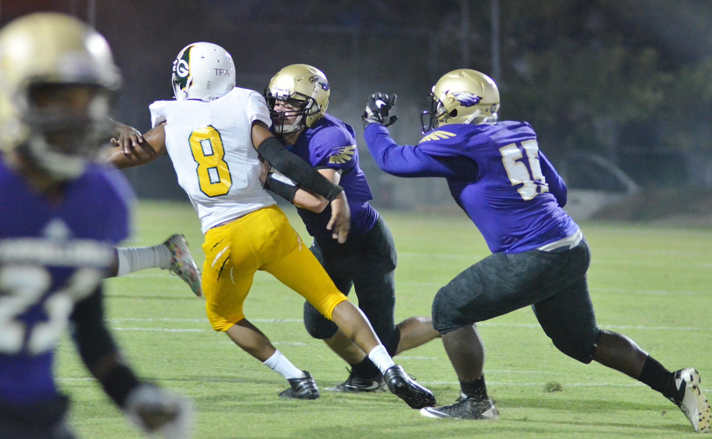 CHS junior Tristan Johnson, at left, and sophomore Taekwon McCoy tackle.