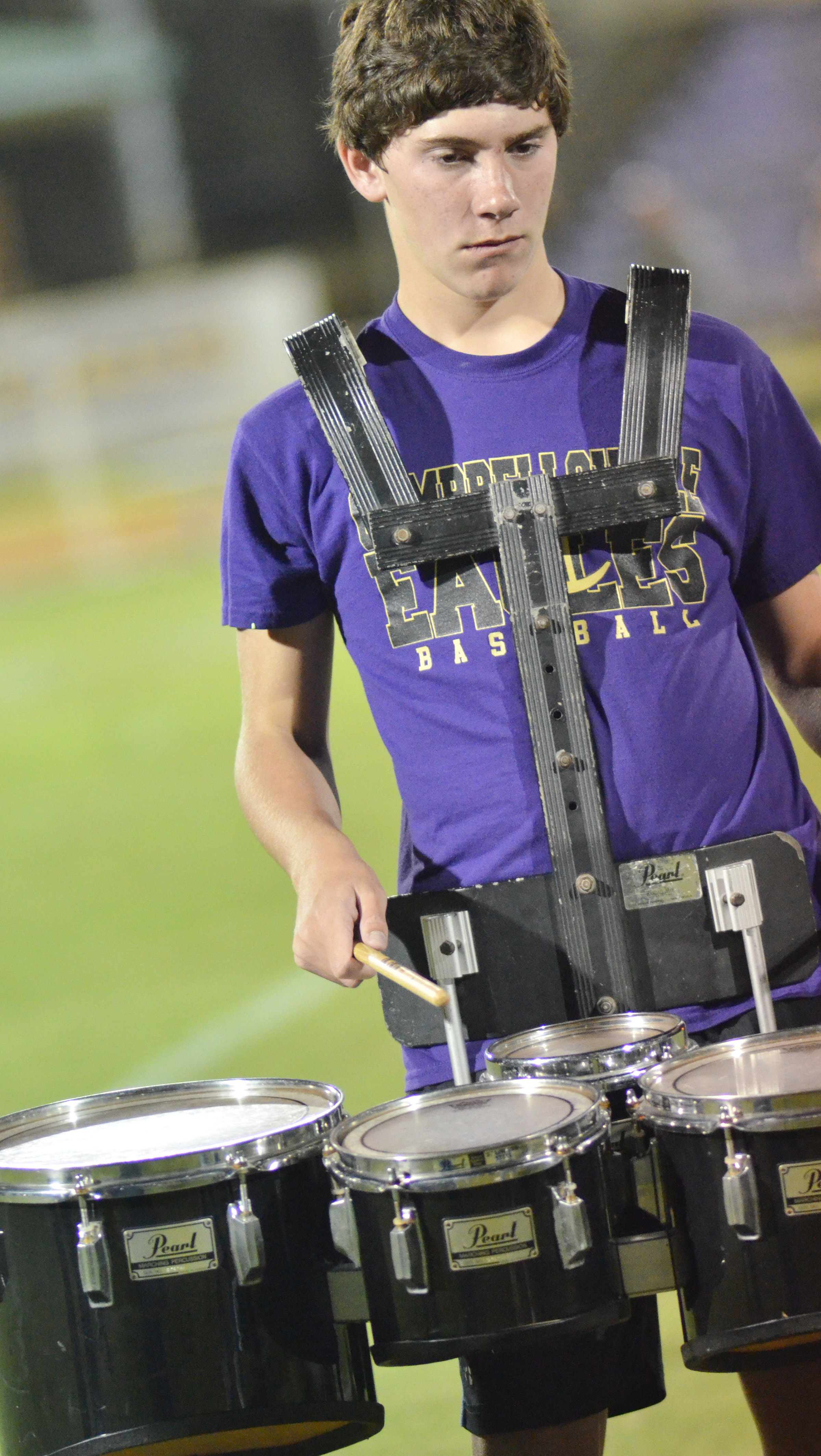 Campbellsville Middle School eighth-grader Peyton Dabney plays drums during halftime.