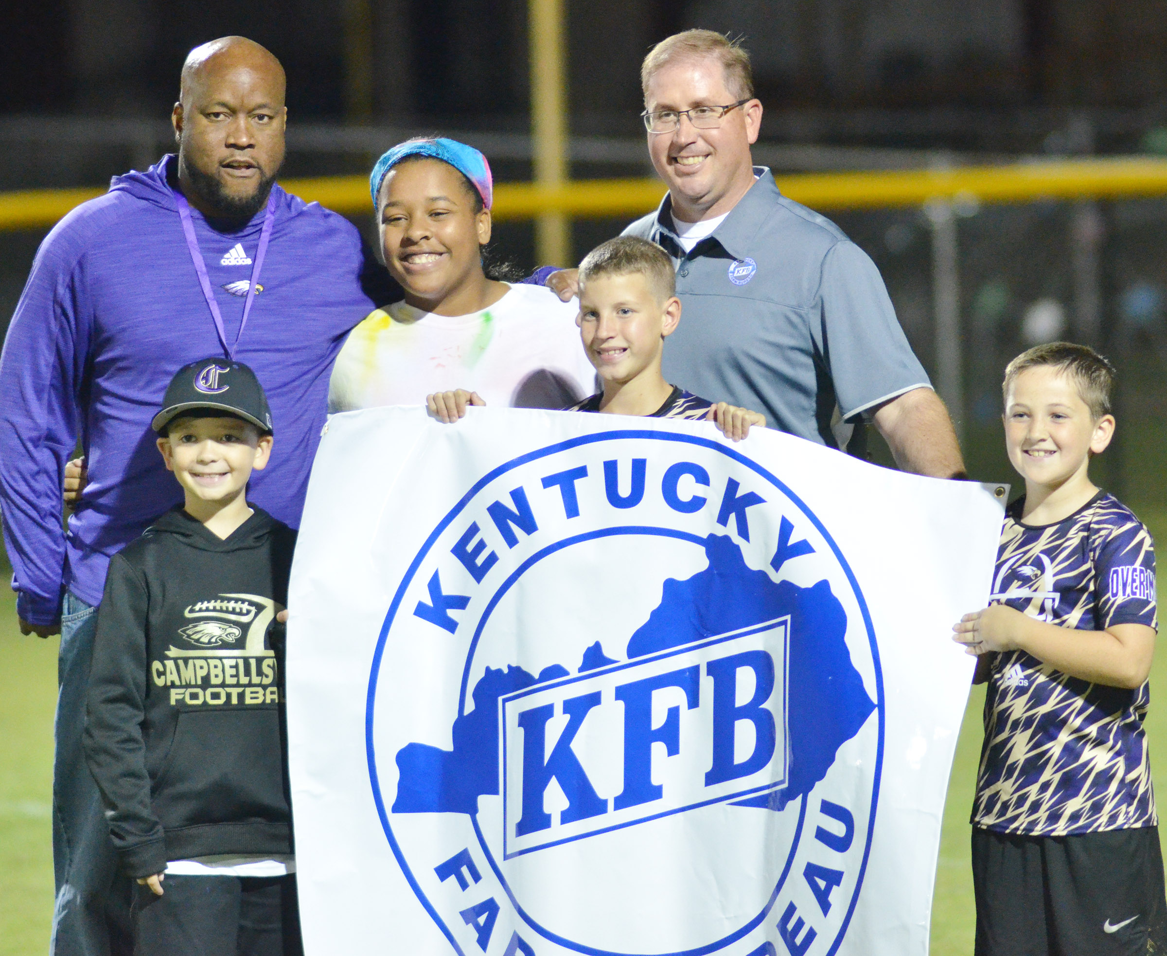 Kentucky Farm Bureau sponsors the Kick for Kids, which awards $50 for a successful field goal attempt during halftime. From left are Campbellsville Elementary School fourth-grader Cameron Estes, CHS girls' basketball head coach Anthony Epps, who made the field goal, CHS senior Kayla Young, who received $50 for Epps's successful kick, fifth-grader Rowan Petett, Farm Bureau agent Darrin Price and third-grader Luke Adkins.