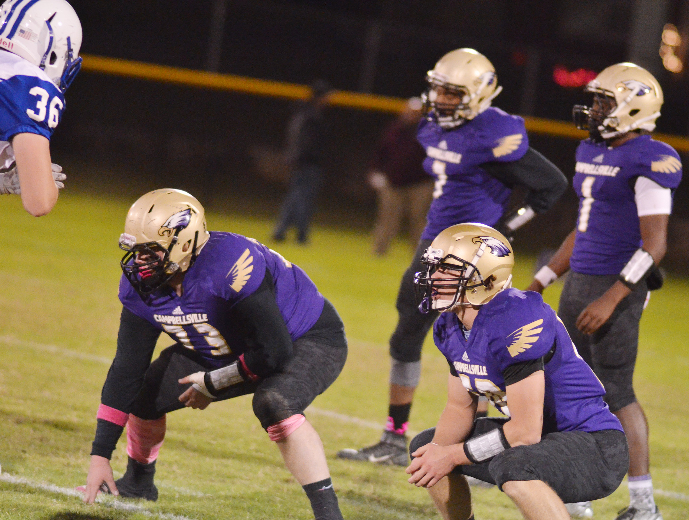 CHS senior Ryan Jeffries, at left, and junior Tristan Johnson get ready for the snap.