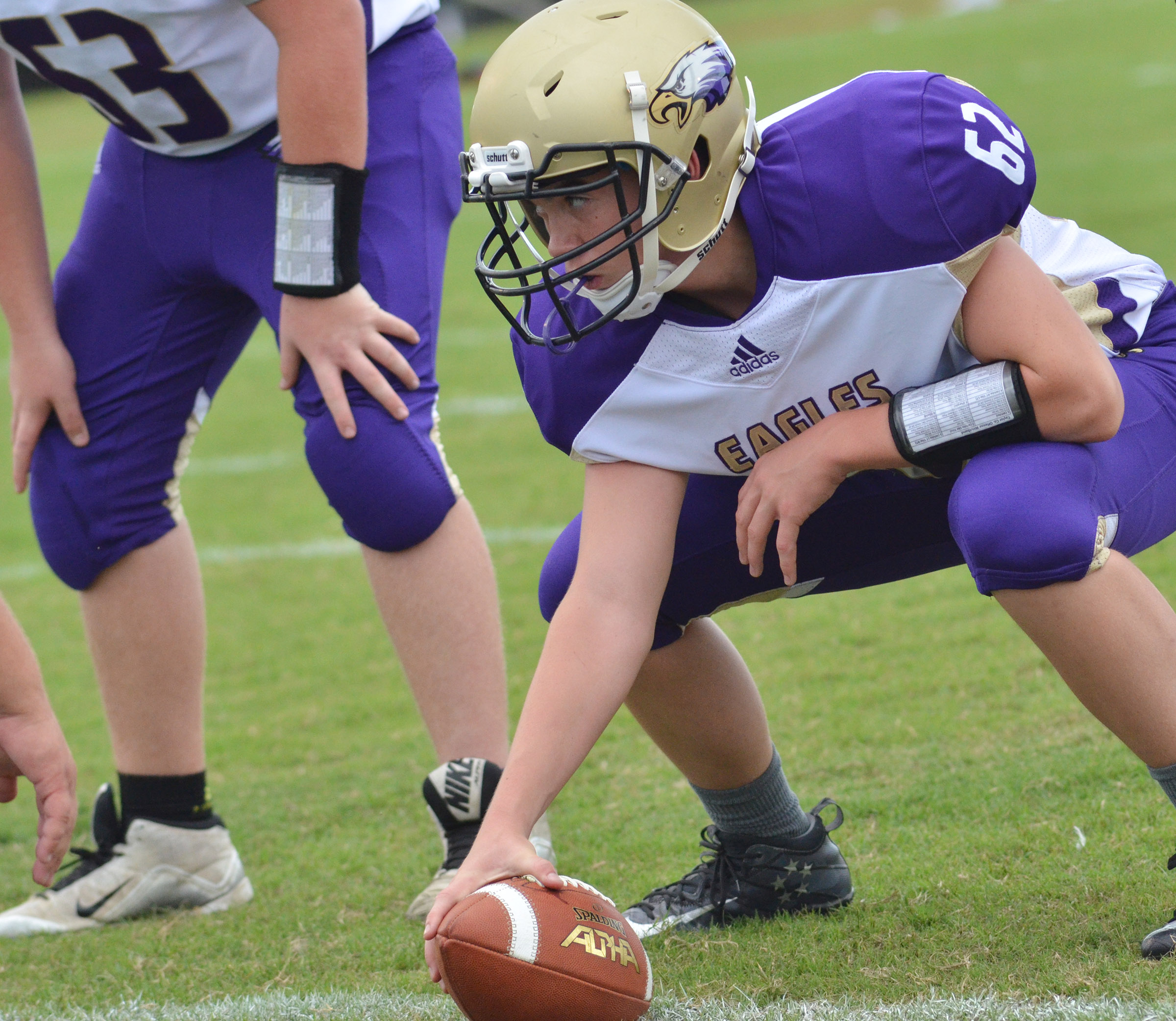 CHS sophomore Cole Kidwell snaps the ball.